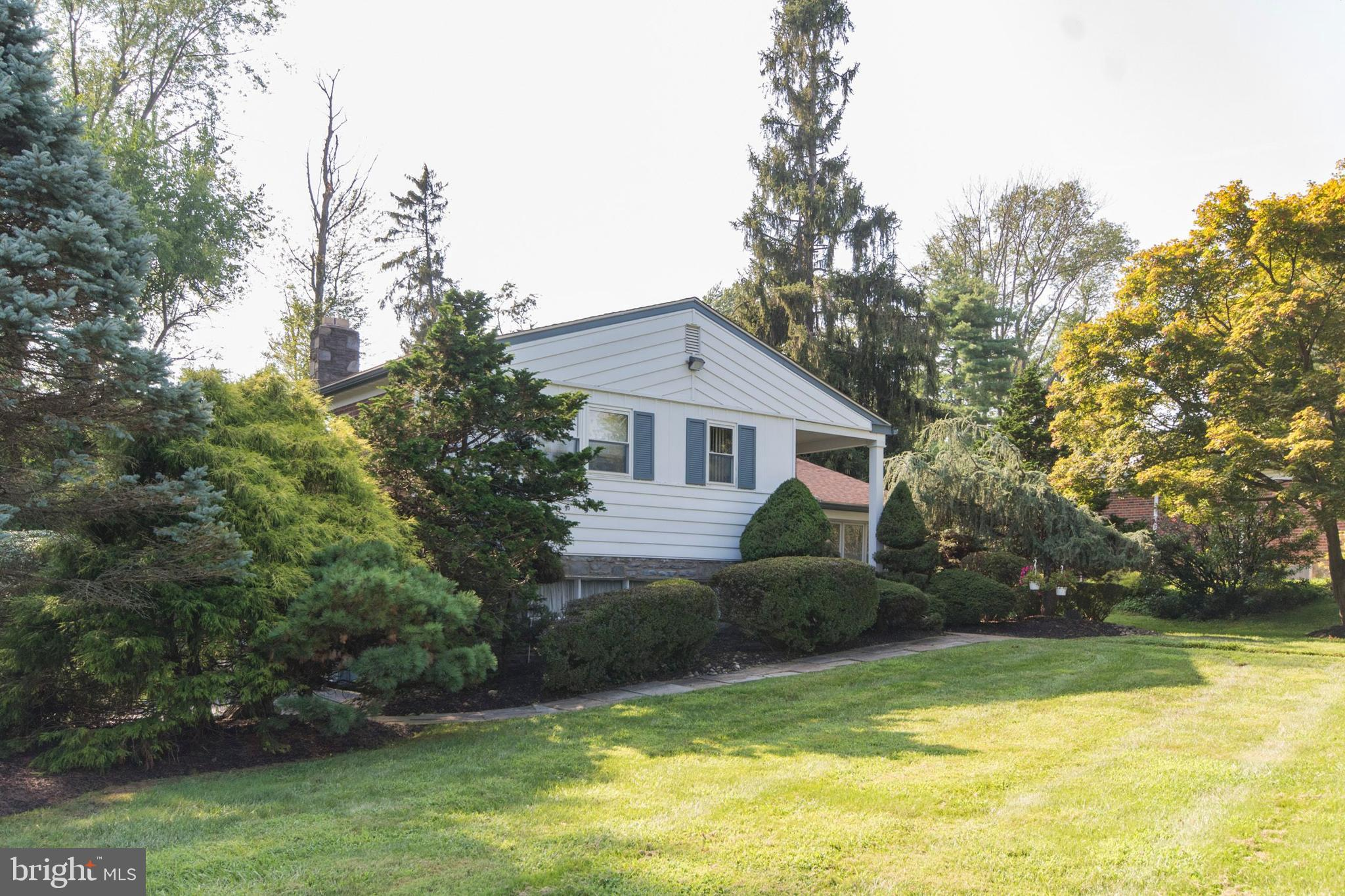 Beautiful, Open Feel Multi Level Home in wonderful condition! Move right on in! Professionally landscaped corner lot on  .45 of an acre!  Ceramic floor entry, step down to the Living Room/Dining Room with hardwood floors, cathedral ceiling, lots of floor to ceiling windows! Not to miss the crown moldings and the high hats! Pocket doors to the Eat In Kitchen with an atrium ceiling and a large Palladium window over the sink, overlooking the deck and the gardens. Dishwasher/stove and microwave are all new! Upper level: Master Bedroom with a huge walk-in Closet and Full Bath, 3 more Bedrooms, Hall Bath with a jacuzzi bathtub, and linen closet. Lower Level: Powder Room, Large Family Room with gas burning stone fireplace and walk out to the rear yard. Laundry room with side door exit, One car garage (was a 2 car garage) with a cedar closet and a huge storage closet with indoor access into the house. Roof was replaced in 2016. Other features include: Alarm system,  LED sensory security lights outside, replacement windows, newer roof! Easy access to the expressway and Center City and parks!