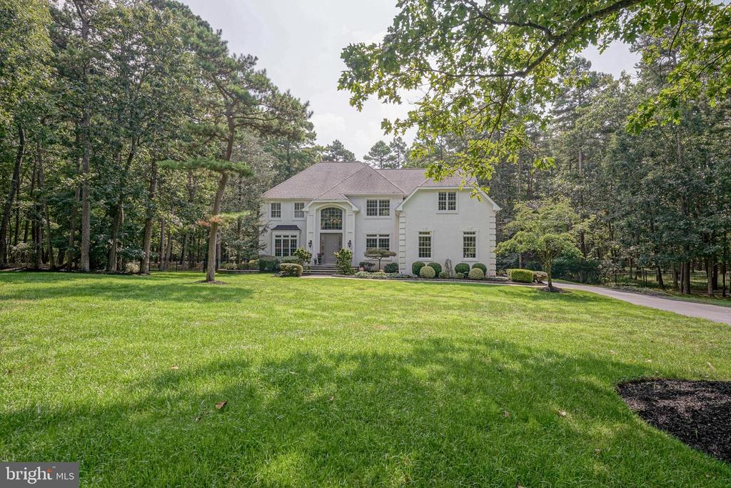 Stunning Estate Home rare to the market tucked away at the end of a cul-de-sac on a private 2.20 acre parcel backing to woods. This 4 bed, 3-1/2 bath gem has over 5000+/-  SF…. plenty of room to roam.  Built by Travarelli 18 years ago, the Owners have spared no expense perfecting the indoor & outdoor spaces.  Exquisitely designed with custom appointments & a well thought out color palette throughout the home.  The first floor offers hardwood floors throughout most of the rooms.  Recessed lighting compliment the spaces. The gourmet kitchen was completely renovated in 2007/2008 and graced by an amazing cathedral ceiling sundrenched sunroom addition off the back of the house.  Incredible flow of the first floor was achieved by opening up this space.  Enter through the dramatic two-story entry foyer, with the eye-catching crystal chandelier a glittering focal point.   To the left is the formal living room respite with plantation shutters, hardwood floors & coffered ceiling. Open to the formal dining room where the hardwood floors continue with perimeter tray ceiling with recessed lighting, chair rail, glamorous double pendant barrel lighting & sliding glass door to the second terrace.  To the right is the private study through French doors complete with well thought out custom built in cabinetry, pattern carpet and blinds overtop a nice sized window overlooking the front yard.  Amazing gourmet kitchen a chef's dream.  Plenty of room to cook & show off for the crowd! Center island with coordinating dark wood and granite countertop.  Custom off white wood cabinetry complimented with granite countertops.  A peninsula with additional seating separates the kitchen & the sunroom.  There is also a large breakfast area with plenty of room for a large table & a built-in wet bar.   Magnificent exhaust hood with beautiful tile detailed backsplash.  Full stainless-steel high-end appliance package including:  Viking Professional:  4 burner with griddle cooktop, oven, microwave and w