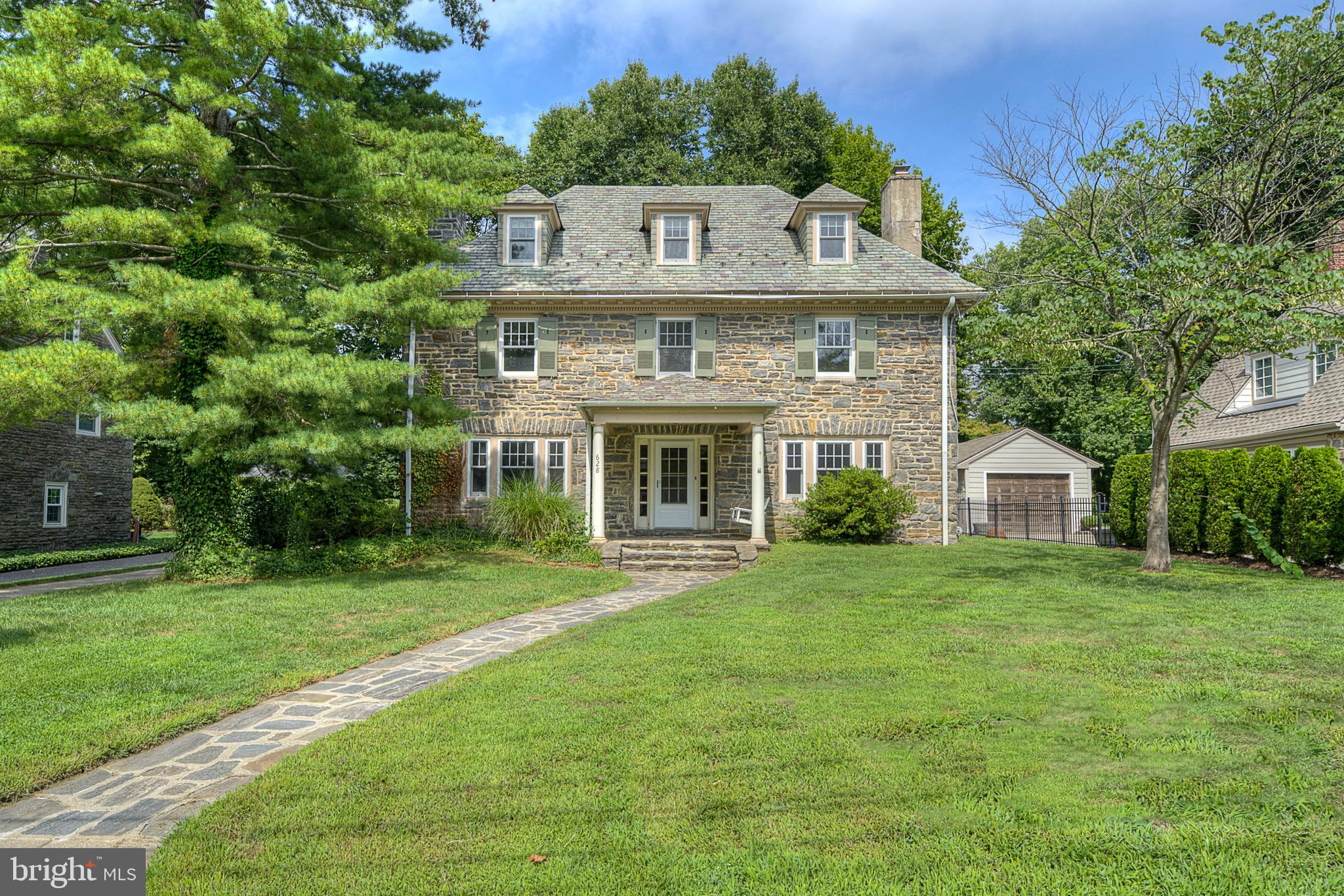Look no further… this is the home you have been searching for! This beautiful, spacious 1920 stone home, located in the highly sought after Merion Golf Manor, is full of antique charm. The property backs up to a scenic walking trail and the esteemed Haverford College. Overhill Road offers a wonderful family neighborhood where you can enjoy family block parties and community family get togethers throughout the year! Upon entering the foyer, you will find formal dining and living rooms, both with wood burning fireplaces providing both comfort and elegance. As you continue through the first floor you will enter the kitchen equipped with butcher block countertops and a seating area suitable for family and friends. From the kitchen, you will find access to the basement with hookups for the washer and dryer and a large sized utility sink. The second floor offers three bedrooms, two bathrooms, and an office that can also serve as an additional bedroom. But that's not all!  An additional third floor contains two more spacious bedrooms and a full sized bathroom. There is plenty of living space in this one-of-a kind home! Your future home is conveniently located near popular local hotspots like Merion Golf Club, Carlino's Market, Tired Hands Brewery, and Suburban Square-one of the most lively places in the Philadelphia area to find today's trending shopping styles, restaurants, and so much more. The local train line is close by to take you directly into Philadelphia and nearby destinations. Do not miss out on this opportunity to own this home and become the envy of all your friends and family!