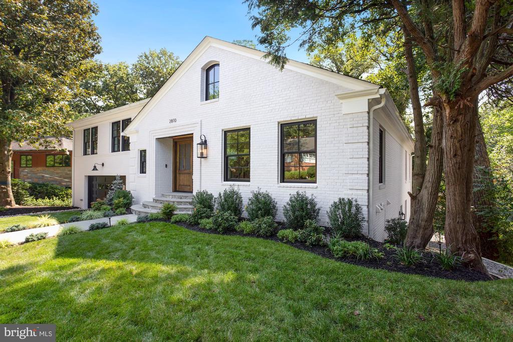 Come meet the developer at this Sunday's OPEN HOUSE!! Sunday, 9/19th between 1-3pm.    2810 Ellicott Street, nestled in sought after Forest Hills neighborhood of NW DC, is comprised of 5 bedrooms, gym, 4.5 baths, over 5,300 sq. ft of living space with an open and defined floor plan perfect for everyday living to full scale entertaining. Clad with transitional elements and design, this home lives a timeless elegance suitable for the most discernible buyers.    Once inside, you are welcomed with gleaming white oak herringbone floors and tons of natural light from the numerous Jeldwen windows. The natural hardwoods compliment the neutral toned custom cabinetry throughout the kitchen. Designed for the master chef in mind, the kitchen is fully equipped with top of the line JennAir RISE Series appliances, an oversized borghini gold quartz 10' island with bar seating, as well as Kohler Artifacts fixtures and designer backsplash. The kitchen's crisp lines seamlessly flow into the bright and large dining room as well as the family room complimented by one of two gas fireplaces.   Dual french doors open to a private expansive composite deck as one of two outdoor living spaces. The home offers a luxurious Owners suite to include a spa-like, lush bath that opens to an expansive custom milled walk-in closet with hidden door opening to an additional loft space office and laundry room. No details were overlooked as the home offers a private guest suite with walk in access and full bath as well as a personal home gym with a separate side entrance and laundry room.   Further enhancing this home's desirability, the basement level lends itself to an array of activities being fully finished with walkout access to a palatial 3 Season Room adorned with brushed marble tile overlooking the lush trees fenced in spacious backyard. The alluring park views and privacy are only emphasized with the home's location being nestled on a quiet and private street with the convenience of being in close