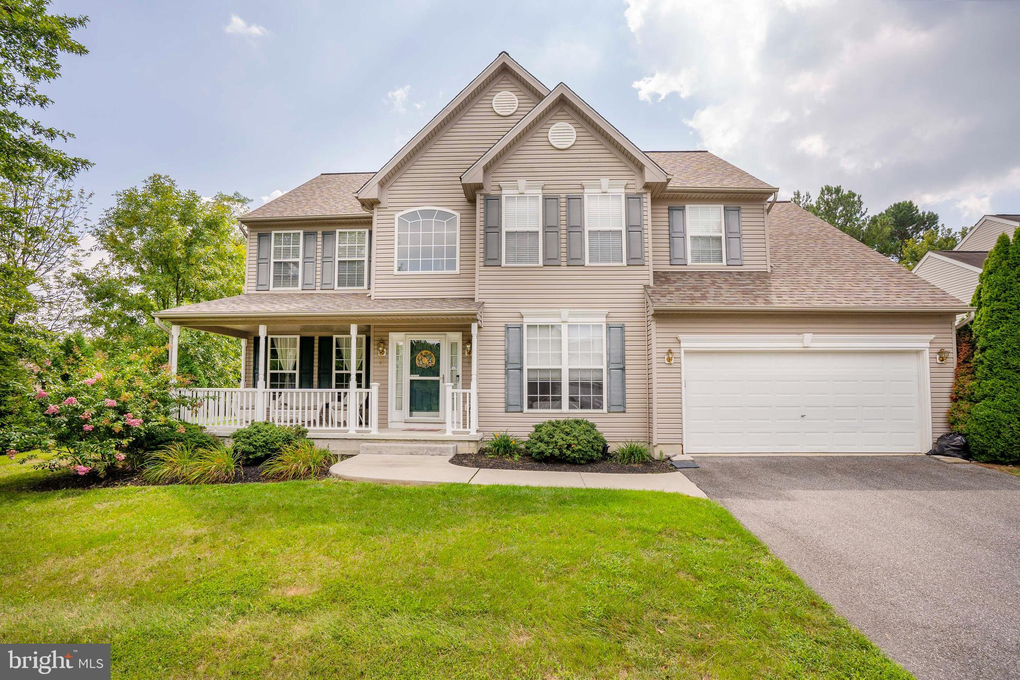 This well loved and maintained home, located in the fantastic neighborhood of Bayview Manor, where pride of ownership shows and friendly waves are a common sight. Immediate proximity to the recreation of the Kirkwood Soccer Club. Right as you arrive you will be drawn to the premium lot with well-maintained landscaping.  Walk up to the welcoming porch! 2-Car Garage with extra ceiling storage, NEW ROOF-2019, NEW HEATER-2019. The 4-bedroom, 2.5 bath floor plan begins with a wide foyer for a bright homey welcome. The living room is complete with crown molding.  Beyond the dining room, the kitchen was wisely enlarged to make room for GRANITE countertops, an island and a breakfast area that opens to a sunny Trex deck. The family room, complete with Brazilian Teak wood floors, two story high ceilings, a fireplace, skylights, and a wall of windows also opens to a wooded view, this one offering relaxation. The yard beyond is just heavenly with plenty of privacy plantings and spring blooms, as well as the luxury of open space and woods adjoining.  Office or den (the possibility is yours!)  conveniently located on the main floor.  Main suite further impresses with vaulted ceilings, walk-in closet and a private, bright bathroom with loads of storage and a huge soaker tub.  Down the hall you will find three large, freshly painted and newly carpeted bedrooms.  Don't miss the clean basement with endless possibilities.  Egress window already built-in and two new sump pumps!! This yard is one you will not want to miss.  A rare property that backs up to woods.  Call today to schedule your tour!