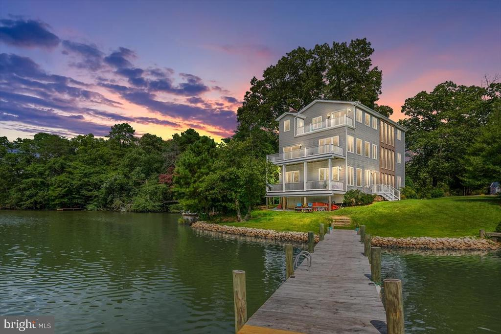 Completely Custom 3.30-acre waterfront property with 80ft pier and 235 feet of waterfront on secluded Black Hole Creek.  Stunning water views from every room.  The home has 5 bedrooms and 4 and 1/2 baths with decks on all 3 levels.  The foyer invites you into this amazing 3 story staircase leading to 12 water view windows with beveled prairie grids.  The first floor offers an office or in-law suite; with a full hall bath.  The great room features a large fireplace, gourmet kitchen and open dining space.  The kitchen has custom cabinets, granite counter tops, and island cooktop. Adjoining pantry with tons of storage space.  Enjoy the water view as you ascend the steps to the second floor. Open floor plan with refrigerator, dish washer, counter and sink for entertaining on the second level.  Jack and Jill bathroom with double sink has direct access to one bedroom.  Second bedroom has both a pond and creek view.  Third floor includes two-bedroom suites with Juliet balconies overlooking foyer.  The master bedroom features a jacuzzi tub with fantastic water view and door to the deck.  Master bath has separate toilet and shower room with window and tiled shower seat.   Beautiful unique mostly wooded property with large pond.  Wildlife abounds, great area for bird watching, walking and bike riding.  30 minutes to Baltimore, 45 minutes to Washington, and a half hour boat ride to Annapolis.  No flood insurance required!!
