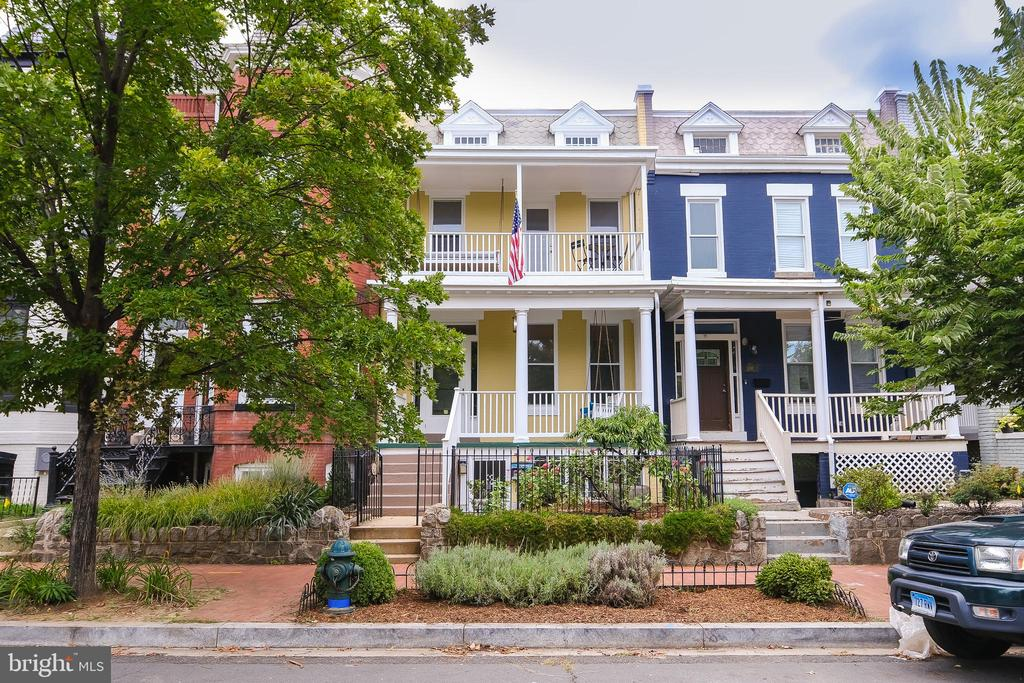 This is your opportunity to own this beautiful Grande Dame on Capitol Hill.  Built in 1909, this stunning 2630 sq ft, four bedrooms, 2.5 bathrooms home offers more than most.  A charming front porch, balconies off two of the bedrooms, wonderful original features,  2 wood burning fireplaces perfect for those cozy winter evenings, newly finished wooden floors, high ceilings,  closet space galore and pocket doors separating the living  from the dining area plus so much more. There is an added bonus of a  one bedroom basement unit with a CofO, a perfect earner or au pair suite. The rear garden is stunning, almost a 1000 sq ft, professionally landscaped designed with a water irrigation system, a perfect place to enjoy a glass of wine on those balmy evenings.   At the end of the garden is a spacious garage for off street parking. All this just off beautiful Lincoln Park and within a 12 mins walk to Eastern Market metro, Stadium Armory  and Potomac metro, plus all the bars, restaurants and supermarkets Capitol Hill and H Street has to offer.