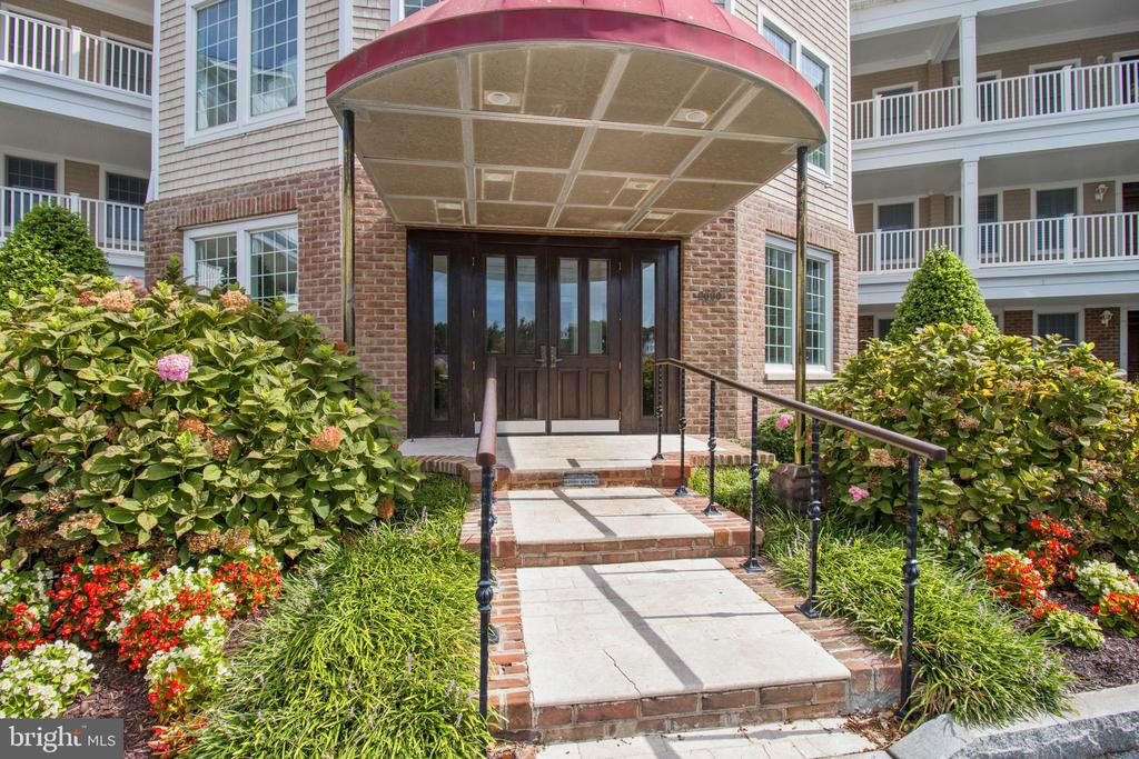 """WOW will be the first words out of your mouth when you walk into this unique """"Pivot"""" unit in  sought after Points Reach at The Point in Ocean Pines! Every detail was considered throughout this 3 bed, 3 full bath home, with an additional half bath in the hall way for guests.  Sweeping panoramic waterviews of the Ocean City skyline and Turville Creek. Italian marble flooring in the bathrooms and on each of the TWO patios.  The outside also boasts a Viking built in gas grill for your use!  Granite countertops in the kitchen and Jenn Air stove, ovens (two) and microwave. California closets in 3 master closets and 1 foyer closet.  Geothermal heating and air, as well as a gas fireplace and tinted windows.  West Coast Hollywood Infrared Sauna is just one more thing to enjoy about this home! Bike storage for owners and all the amenities that Ocean Pines has to offer!  Multiple pools, golf membership available, tennis courts, pickle ball, multiple parks, and the list goes on and on! Make an appointment to see this today.  Do NOT miss out! Motivated seller"""