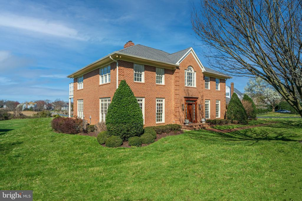 A chance to live in Fishing Creek Farm!!! NEW NEUTRAL PAINT THROUGHOUT THE ENTIRE HOME (not reflected in pictures) Highly Motivated Seller!!! Entertaining ALL Offers. Now is your chance to live in the most sought after community in Annapolis - Fishing Creek Farm!   This Luxurious 6 bedroom 6 bath in the desired waterfront community of Fishing Creek Farm is a dream home situated on a picturesque corner lot with an EXPANSIVE YARD and Spans over 6,500+ of livable SQFT. This magnificent residence graced by soaring ceilings and expansive windows invites comfort, and exudes one of a kind charm. The grand entryway draws you into a voluminous layout made for relaxing and entertaining. Feel right at home with an elegant formal dining room, home office, tremendous Chefs kitchen, two great rooms with a wood burning fireplace and glass  doors that open to the rear deck which overlook breathtaking water views. Travel up the marvelous grand staircase to the Master Suite which presents two walk in closets, an updated master bath with soaking tub, and a private deck overlooking the water to enjoy magnificent sunsets. Down the hall houses three other spacious bedrooms with their own opulent en-suite baths. The newly finished lower level includes a large rec room with a wet bar, wood burning fireplace, laundry room, full gym, ample storage, and an expansive bedroom with a full bath.  Park your boat at the community marina conveniently located steps away from your door. You'll also love the convenience of being near it all! Great shops, schools, restaurants, and the metro just minutes away.   Timeless, Impeccably well thought out details, and custom built with only the finest materials. PLEASE NOTE : We have approved plans by the HOA for a backyard pool! Please refer to attached listing documentation.  COMMUNITY PERKS OF FISHING CREEK FARM -  New Community Beach, New Kayak Launch, Jet Ski Platform, Community Marina, Pool, Clubhouse, Tennis & Pickleball courts, And Community Events suc