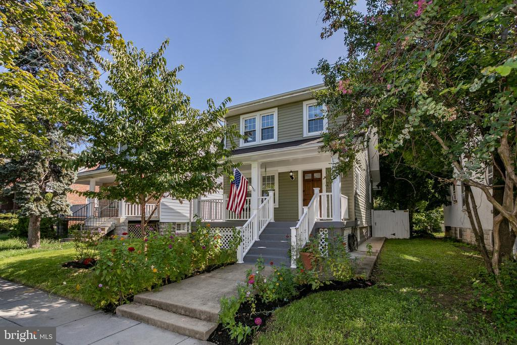 Beautiful detached 4 BD/2.5 BA porchfront home with fully-fenced 3500+ square foot yard. Enjoy abundant natural light and freshly refinished hardwood floors on the main level. The living room contains a powder room and opens to the separate dining room and back sunroom, the perfect location for a home office. A French door leads to the deck and an enormous back yardideal for gardening, pets, parties, and playdates. The home chef will adore the large renovated kitchen with new white marble countertops and peninsula space for dining.  Upstairs are three bright bedrooms and a renovated bathroom with tub. The generous lower level is fully finished, has an exterior entrance, and includes a cozy den, laundry area, guest bedroom, and full bathroom.  Woodridge neighbors treasure the quiet, tree-lined streets and plentiful green spaces including 22-acre Barnard Park. Walk to the Woodridge Library and a charming strip of local restaurants and shops onRoute 1, or take a short drive to access the urban amenities of Brookland, Union Market, H Street, and Capitol Hill.