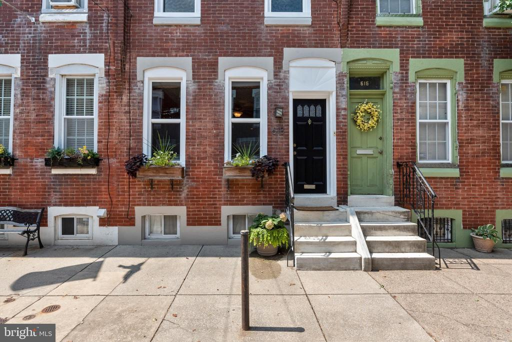 Prime location and a charming tree-lined street make this fully updated home one-of-a-kind. This rarely offered home, surrounded by trees on a quiet street, is literally one block from the South St bridge that connects you to I-76, CHOP, UPenn, and Drexel, and a few blocks away from 30th St station, Amtrak and regional rails, Rittenhouse Square, Comcast, parks, center city, cafés, and restaurants. What is also rare about this home is its perfect layout. The upstairs was reconfigured when the house was fully updated a few years ago. The primary bedroom is spacious and boasts a massive walk-in closet. Even better, the washer and dryer are located on the second floor in a thoughtfully designed closet which includes a storage cabinet, shelving, and clothes rod. The full bathroom has also been remodeled, giving it great space and functionality. The first floor is spacious enough to include a living area which can have a dining table next to it (where the piano is currently located), powder room, coat closet, a large kitchen with radiant floor heating, ample cabinets, a breakfast nook, and sliding doors to the private backyard/ patio. This home is your chance to live steps away from everything Center City Philly has to offer, right off of main highways, on a quiet tree-lined street, and in a modern home with a perfect layout.