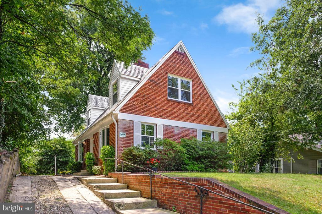 Just Listed! Beautiful Brookland detached home on a tranquil tree-lined street. This unique 4BR/2BA home features great natural light, gracious storage, and charming original details. Upon arrival, you are met by a long driveway that leads to the expansive rear yard. You are greeted by gorgeous refinished original wood flooring throughout, two spacious main floor bedrooms, and a full bath with a shower. Enjoy the wood-burning fireplace with its original mantle for cozy nights at home. The eat-in kitchen is spacious, sunny, and bright. The second floor opens to a comfortable den or study that leads to two spacious bedrooms and an updated 2nd bathroom.   The grounds are perfect for garden enthusiasts! The rear yard is your playground and awaiting your vision. Two patio spaces make this area the perfect place for an outdoor kitchen. This will be a central gathering place for outdoor entertaining. There's even room for a trampoline! Not only is this home elevated with a landscaped front yard, but it also offers off-street parking for 2-3 cars.  1419 Girard Street is a short distance to all that Brookland has to offer including Primrose, Brookland's Finest, Masala Story, and Menomale, Yes! Organic and more. The Brookland and Rhode Island Ave Metro Stations are both under a mile away. Also close to parks and a recreation center with play areas, indoor pool, and tennis courts. This well-priced Brookland home is the inner-city retreat you've been waiting for!