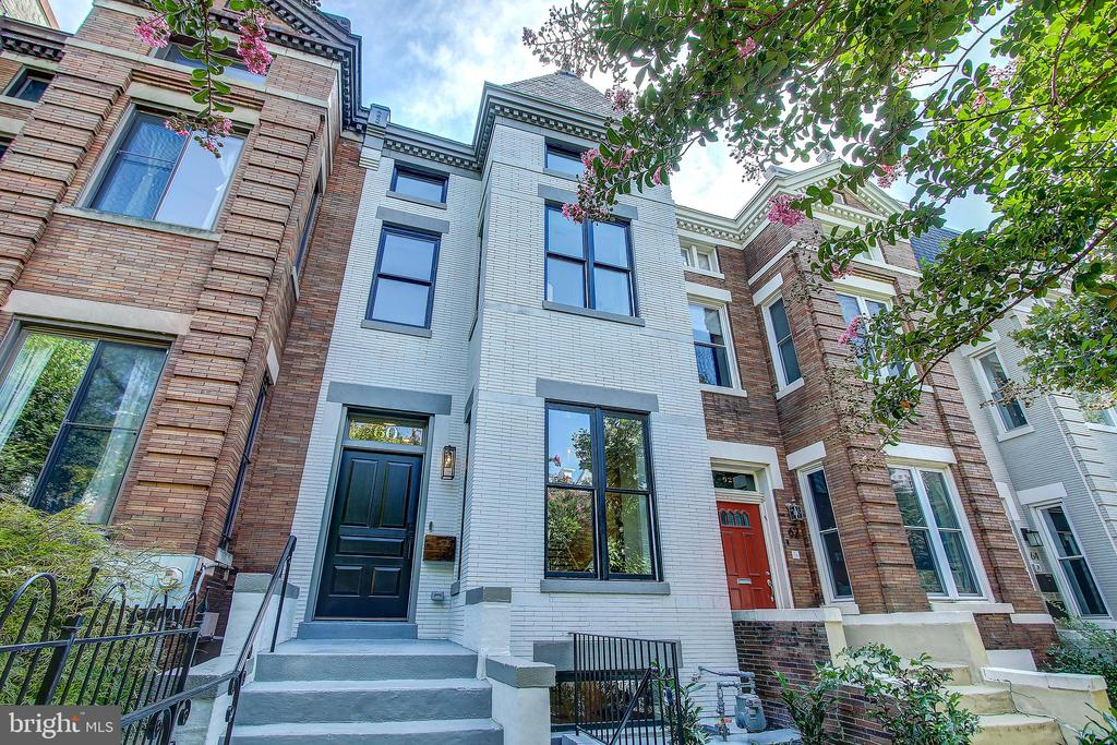 Stunning renovation by Dilan Homes of an expansive c. 1909 historic rowhome in coveted Bloomingdale. Breathtaking view through the main level with soaring ceilings, gorgeous white oak floors from District Floor Depot, a top of the line chef's kitchen with Viking appliances and custom inset cabinetry leading to a rear wall of floor to ceiling glass doors looking out to a fabulous deck, backyard and secured off street parking. The large open floor plan features 3 gracious bedrooms and 2 bathrooms upstairs, a powder room on the main floor, and a fabulous, fully finished lower level with 1 bedroom/1 bathroom, kitchenette, separate washer/dryer set and front and rear separate entrances . With sumptuous bathrooms, a magnificent master suite, dream windows and skylights, Circa lighting, custom millwork, abundant storage space and built in closet systems throughout, every aspect of this sophisticated residence was thoughtfully considered. Walk to Shaw, U Street, LeDroit Park and everything Bloomingdale has to offer.  Fully fenced in rear with deck, flagstone walk, grassy yard, and parking pad for multiple cars and roll up garage door. This is a spectacular home.