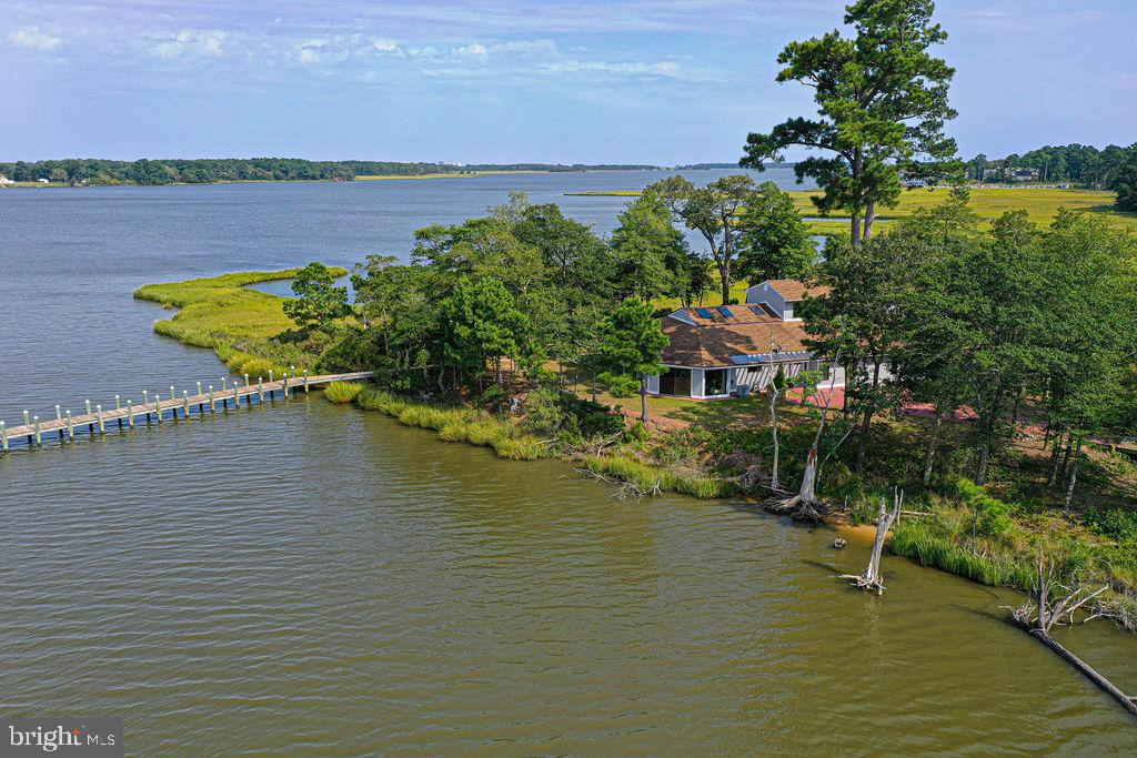 Rare Opportunity to purchase your own Private  Island!!  Did you ever wonder what lies across that bridge at the end of Marina Drive in Saint Martins by the Bay?  Now you could own it!!  Glass doors and windows everywhere take advantage of the panoramic 360 degree water views! Enjoy amazing sunrises and sunsets all year long!  A long pier guides you to navigable water, and includes a boat lift and 2 jet ski lifts.  The spacious 4 Bedroom, 4.5 Bath home has nearly 4,000 square feet!  Enter into a sunny two story Great Room with 6 skylights! Each Bedroom has it's own private bath .  Lots of ceramic tile!  Second level loft area.  Community Swimming Pool and Tennis Court.  Lots of wildlife, shore birds and bald eagles!!