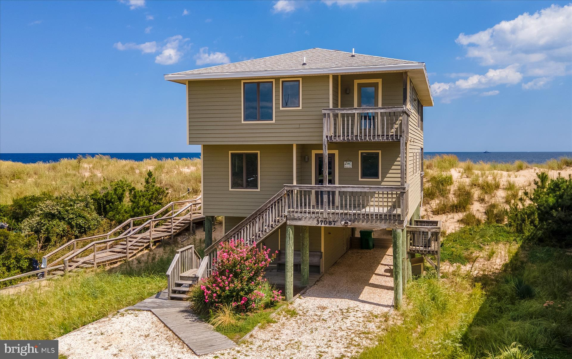 Rare opportunity awaits! A meticulously maintained oceanfront property in the gated community of Fenwick Acres. Relax with your morning cup of coffee on the spacious deck or eat dinner inside the screened-in porch while enjoying unbeatable views of the gorgeous Fenwick Island State Park beach. The inverted floor plan allows for maximum ocean views from the kitchen and living rooms and the open layout provides the perfect space for entertaining.  With 3 bedrooms on the main floor and 1 on the top floor, there is plenty of room for friends and family.  Additional features include 2 wood burning fireplaces, a new HVAC in 2016, 2 secure storage sheds, and a full outdoor bathroom, perfect for those long days on the beach. Just a short bike ride away from the shops and restaurants of Fenwick Island, this home is a must-see!