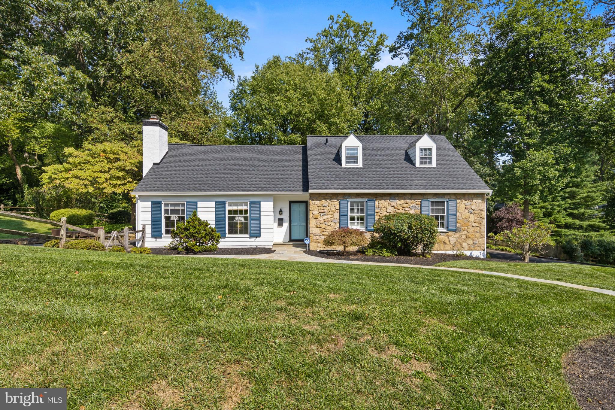Don't miss this great home in sought-after Strafford Village! Fresh, neutral décor and many updates make this 3-4 BD, 2/1 BA stone Cape Cod colonial move-in ready. The bright and sunny Living Room features a fireplace and has open flow to a gracious Dining Room. The renovated Kitchen offers expansive counter space, custom cabinets, two sink areas, and breakfast bar seating. This home has a unique, flexible floor plan with potential for one floor living. On the 1st floor, Bedroom 1 has en suite access to the large, renovated Hall Bathroom and laundry area. Bedroom 2 is currently used as an exercise room, but could also be a Den, Office, or Master dressing room. Upstairs, Bedroom 3 is currently used as the primary bedroom and features a large walk-in closet. The spacious upstairs full Bathroom features a large furniture-style vanity, large tub, separate shower, and also serves Bedroom 4.  Both upstairs bedrooms are very large and have bonus under-eave storage closets. Relax and entertain on the large flagstone patio, overlooking the well-landscaped yard, with level grassy lawn for recreation. An add'l 440 sq. ft. of finished living space is found in the Lower Level, which has a Mudroom, Powder Room, Family Room, and a Bonus Room, ideal for exercise gear or home office. Two unfinished basement storage/utility rooms plus an oversized, freshly painted 2-car garage provide ample storage. Great location in award-winning Tredyffrin-Easttown School District. Wonderful neighborhood with events throughout the year that foster a strong sense of community, including holiday parties, dinners, and 4th of July parade and picnic. Enjoy live music and dining at the wide variety of restaurants in the charming village of Wayne, and shopping at the Strafford Farmers Market and DiBruno Brothers. Conveniently located just a short stroll from Strafford train station, parks, playground, library, and public transportation with easy access to Center City, Airport, and corporate centers.