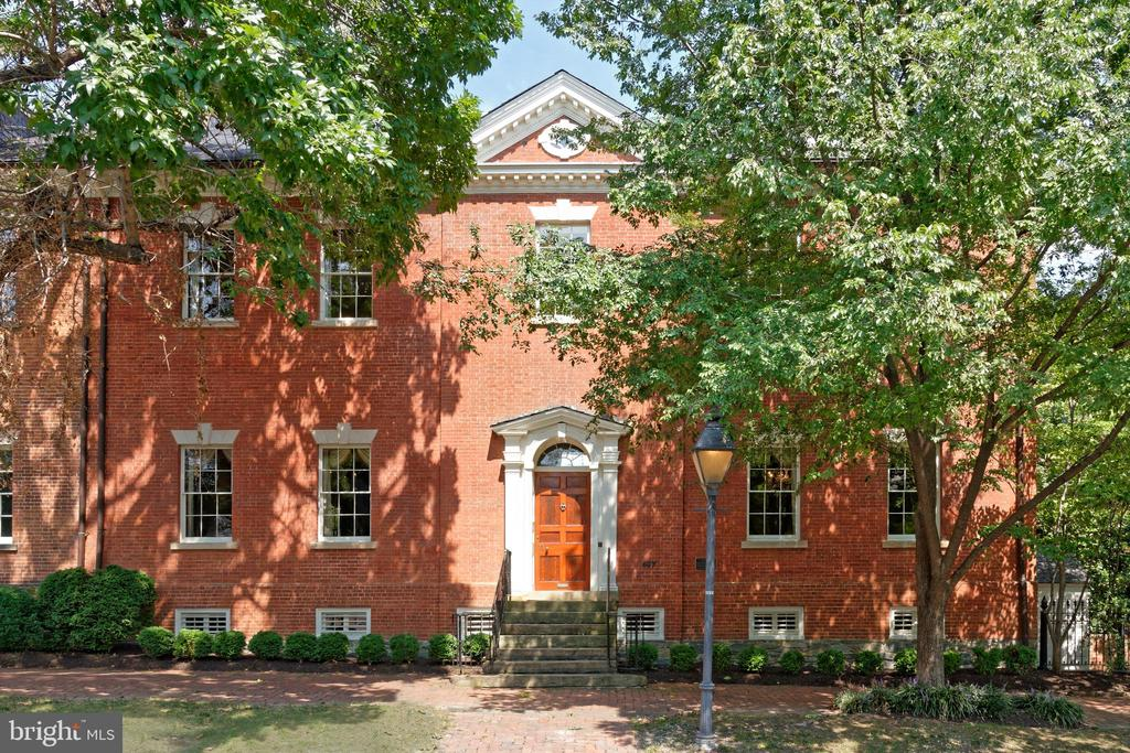 A rare offering, the Potts-Fitzhugh House resides on a half-acre double lot in the heart of Old Town Alexandria. The grand entrance greets you to a storybook foyer with magnificent architecture juxtaposed with historic period details and natural light creating both a majestic yet warm scene. Beyond the entry, the main level offers ideal settings for unforgettable entertaining with an oversized great room, stately dining room, and gourmet kitchen. Designed with traditional elegance, this timeless estate is light, bright, and open throughout. The unique, expansive primary suite is the perfect escape that boasts a custom dressing room and spa bath with dual vanities and a soaking tub. The home features five additional bedrooms and four additional bathrooms. Equally impressive, outside the home, the verdant garden awaits. With patios, countless specimen trees and lush grounds, this estate is truly magical. Just through the garden, you will find the bonus, detached two-car garage and studio space. Significant renovations and professional restorations over the years have been completed with great attention to detail.  This masterpiece for the most discerning buyer is  located on a quiet, charming block steps to the Mt. Vernon Trail, the Potomac River, shops and restaurants on King Street, and easy access to National Airport, Metro, Amazon HQ2, and major commuter routes.