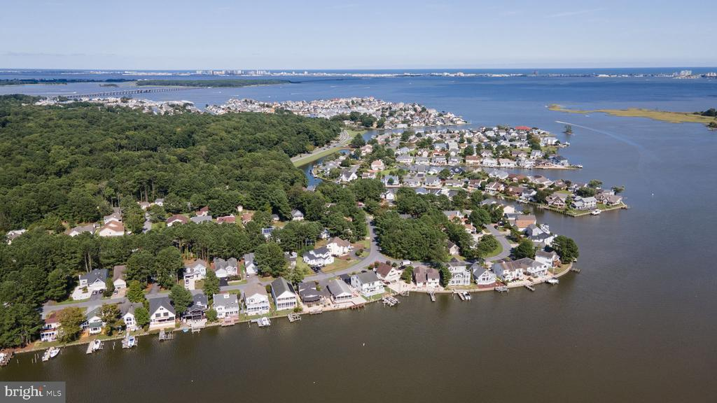 Pending Release Fantastic views, great location! Boating right from your own deep water dock to Ocean City, Assateague Island or the Yacht Club makes this a one of a kind location. A vacation or permanent home you'll never  want to leave. Biking, crabbing, kayaking and paddle boarding makes this an exceptional neighborhood. This gem is located on one of Manklin Creeks widest unobstructed views.  Endless beauty of waterfowl and magnificent sunsets are like no other.  This desirable location is within  minutes of the Ocean Pines  Library, Post Office, Yacht Club and numerous pools, including a pool with parking and clubhouse in Ocean City on the beach. Several Golf Courses and numerous restaurants, banks, farmers markets, grocery stores and more add to making this one of the best communities! This 3 bedroom, plus office and 2.5 bath is one of the few homes with a large attached  2 car  garage. The panoramic  screened front  porch  and winter sun porch provide year round enjoyment. Original builder and owner.