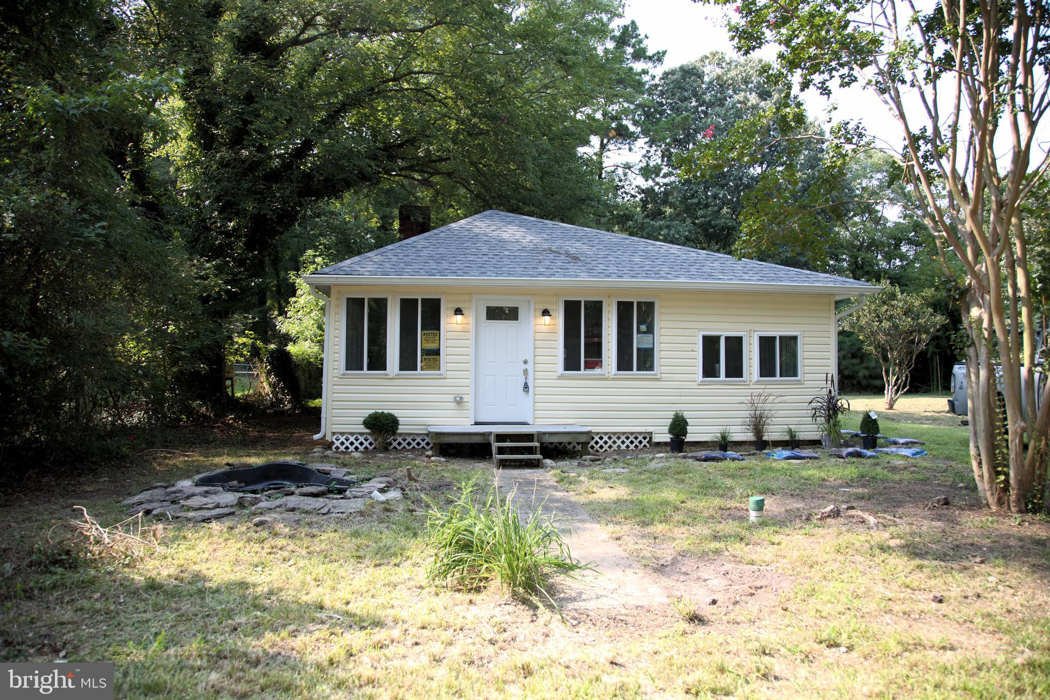 Completely  remodeled bungalow/cottage with all new central a/c, new roof, siding, windows, gutters, appliances, flooring, bathrooms, kitchen, wiring, plumbing.  Home is on holding tank. 3 Bedroom, 1 bath cottage with water views.  open floor plan; Detached Garage on over 1/2 acre (.57). Verify flood insurance.