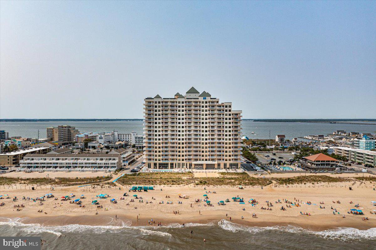 Presenting Unit 414, a unique property in Ocean City's most luxurious oceanfront building, The Gateway Grand.  It boasts all the amenities and features you would expect PLUS a rare, 500+ square foot veranda sets this beauty apart from the pack!  Access to the two-tiered veranda is provided by 3 different patio doors.  Located on the north side of the building, its expansive views of the ocean, bay and city lights fuel world-class outdoor living (please view drone video).  Enjoy ocean views, city skyline views, bay views and firework display, all from the comfort of your living room, owner's suite or veranda.  If entertaining family and friends at the beach is important to you, unit 414 is for you.  The unit's interior – clean, modern and bright – has new furniture, decorations and blackout slider blinds.  Its gourmet kitchen features top-end appliances (Sub-zero, Viking), stunning granite counter tops, a convenient drink fridge and breakfast bar.  Three ample sized bedrooms (including a large master suite) plus a pull-out couch comfortably sleep eleven, and the three full baths and many closets make comfortable living a breeze.  This roomy property has never been leased but would make an excellent rental property.