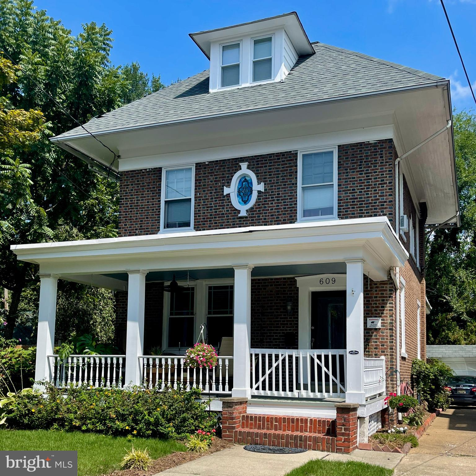 Looking for all the Bells and Whistles in your new home? How 'bout a grant for 17,500 for qualifying Buyers? NO, you do not need to be a 1st time Buyer and NO you do NOT need to pay if back! (Inquire for more info) Looking for Old World elegance and Super Solid Construction along with today's WANT LIST, such as an updated Master En-suite Bath with a Jacuzzi tub & high-end Kohler fixtures & its own Laundry Room! Looking for the convenience of your own Off-Street Parking plus a 1 Car Garage? Well here you go just one house in off Historic Baynard Blvd, 609 W 23rd st offers over 2000 sq ft of graceful living space with great flow, so if you like to entertain you are SET! Start with the Open Front Porch, then enter through an elegant insulated entrance door (with etched glass insert) to a lovely foyer which is opened to the gracious Living & Dining Rooms, which opens through French Doors to the Breakfast/Dinner Sitting area. This sitting area is further enhanced with lots of light streaming through the insulated French Doors giving views of the Private Fenced Back Yard & Trex Deck, complete with an irrigation system!! This sitting space is also open to the well-appointed Kitchen, featuring Maple cabinetry, Granite Counters, Oak Flooring, Gas Cooking, Dishwasher, Custom made Pot Rack, Deep SS Sink with a Gooseneck faucet & Garbage Disposal plus Under Counter Lighting. Off the Kitchen, enter the roomy through-way appointed with Wainscoting paneling & coat/hat hooks & a roomy, updated Powder Room, featuring high-end Kohler Fixtures. This thru-way connects back to the Foyer & Dining Room, creating a comfortable and easy flow. Floor-to-Ceiling bay windows grace the living & dining rooms adding turn-of-the-century architectural detail. Large insulated replacement windows bring in scrumptious daylight all day long. There are several stain glass windows which mark the heightened Craftsmanship evident through & through. Hardwood floors abound throughout the1st & 2nd stories & up