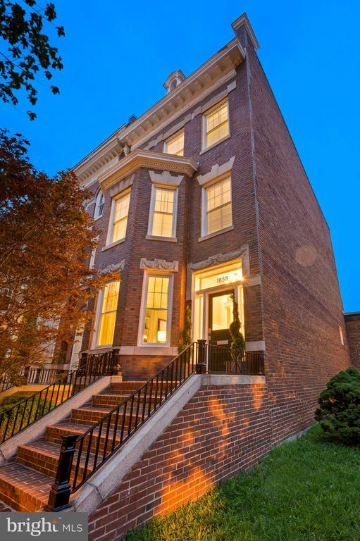 Truly exquisite four level Victorian semi-detached home, c.1911, thoughtfully and beautifully renovated with all modern conveniences and technology, yet retaining the grandeur of its original architecture.  This 7 Bedroom, 5 Full Bath, 2 Half Bath home boasts: soaring ceilings, warm wood floors, over-sized windows, ornate moldings, custom cabinetry, sun-drenched rooms and outdoor entertaining areas on each of its three levels.  All combine to create an exceptional result resonating with elegance in every detail.  The main level open floor plan is highlighted by a glorious Foyer, Living Room with fireplace, Media Room, Half Bath, Formal Dining Room with wet bar and a superb Gourmet Kitchen with custom cabinetry, granite countertops and stainless steel appliances.  Complemented by a Family Room with fireplace opening to a private Deck and Garden.  Located on the second level is the Primary Suite featuring a lovely bay window, fireplace, walk-in closets and a dazzling Bath with separate vanities, 2-person shower and soaking tub.   Completing this level is an additional Bedroom, Laundry, Half Bath, Home Office/Gym and second level Deck.  The third level includes an additional 3 Bedrooms, 2 Baths and another Deck with city views.  The lower level features a spacious In-Law Suite with separate front and back entrances, full Kitchen, Laundry, 2 Bedrooms, 2 Baths and a patio.  In addition, this spectacular home has a FOUR CAR GARAGE with plenty of storage!  Located in the heart of the historic Washington Heights neighborhood - adjacent to Kalorama Triangle and only a half block to one of Washington's most celebrated city Parks - Kalorama Park - 1858 is just minutes to downtown and a short stroll to Columbia Avenue's myriad shops and great restaurants and, of course, Metro!  A very special property - the perfect residence for luxurious, yet comfortable, in-town living.  Come, feast your eyes, and make this wonderful home yours!