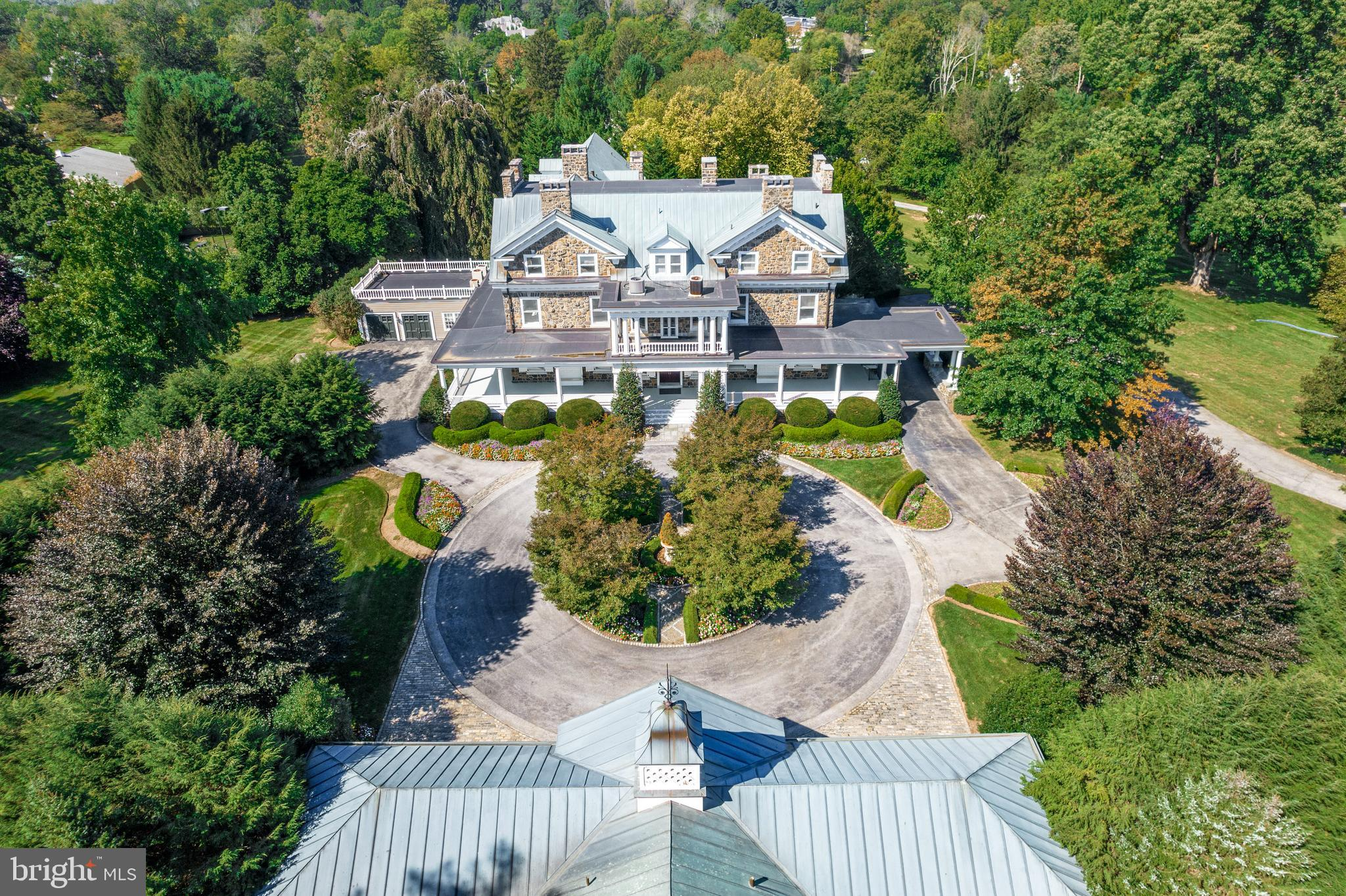 This grand, quintessential Devon estate offers the rare combination of a beautifully restored, tastefully updated and expanded, Georgian Revival residence, set on a breathtakingly landscaped, private, flat 5.19 acre lot , complete with 6-car garage/ carriage house, stunning pool, expansive terraces and destination tennis court.  Look no further and enjoy the graciously proportioned sun-filled rooms with high ceilings, perfectly restored original oak floors, incredible crown moldings, hand crafted architectural features and millwork, massive pocket doors, 6 fireplaces, renovated gourmet kitchen opening up to a fabulous 2-story family room with French doors leading out to the expansive terraces and gardens,  first floor movie theater/ media room, his and hers  offices with  incredible cherry paneling , built-ins and fireplaces, elevator providing easy access to all 4 levels of the residence, expanded master suite with large bright bedroom, renovated marble bathroom with radiant heated floors, soaking tub, frameless glass shower and walk-in dressing room,  8 additional bedrooms which could easily be incorporated together offer expanded guest, au pair and in-law suites, updated electric and HVAC systems, bone dry basement with elevator access, impeccably maintained. This gem offers it all and is close to renowned schools, shopping, restaurants, trains and just 30 minutes from Philadelphia International airport.
