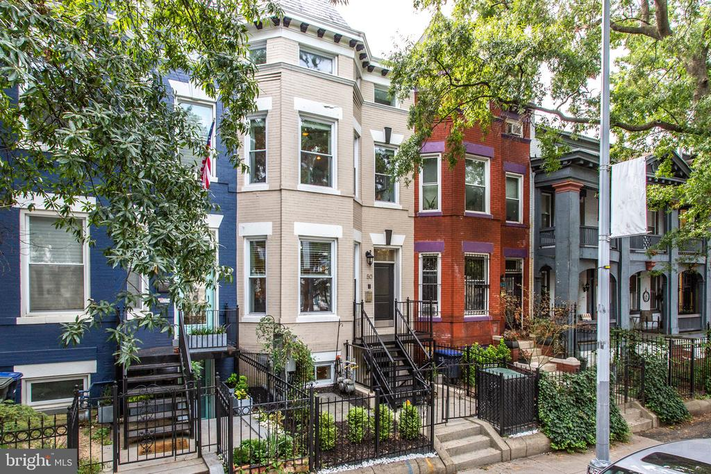 Just Listed. Open Sunday, 09/19 from 2-4pm! Stunning bay front Victorian residence with a legal English basement apartment in the heart of Bloomingdale. Fully renovated in 2016, this stylish home features an open floor plan—ideal for entertaining—with a spacious living room, central dining space with designer lighting, and a well-equipped kitchen with breakfast bar, quartz countertops, stainless steel appliances and gas cooking that is sure to inspire the chef within. A full bathroom and main level bedroom with built in desk and cabinetry are perfect for guests or a home office. Upstairs you will find two additional ensuite bedrooms, including a breathtaking primary suite with double-height ceilings, a large walk-in closet, custom built-in cabinetry with banquette seating and a contemporary bathroom with dual sinks and designer tile, while the secondary bedroom benefits from its own four piece ensuite bathroom. A charming and private rear patio provides theperfect space for grilling and entertaining outdoors. The lower level is a completely separate, spacious and bright one bedroom and one bathroom English basement apartment with high ceilings and an open floor plan. Additional features of this fantastic home includehardwood flooring, recessed lighting, integrated speaker system, in-home laundry, crown molding, terrific storage throughout, very easy street parking and so much more just moments from the Red Hen, Boundary Stone, El Camino, Bacio, Big Bear, Aroi Thai, Yoga District, Crispus Attucks Park and all the additional amenities Bloomingdale and the surrounding area have to offer. Numerous bus lines, major thoroughfares and nearby Metro stations makes getting in, out and around the District a breeze. Welcome home!