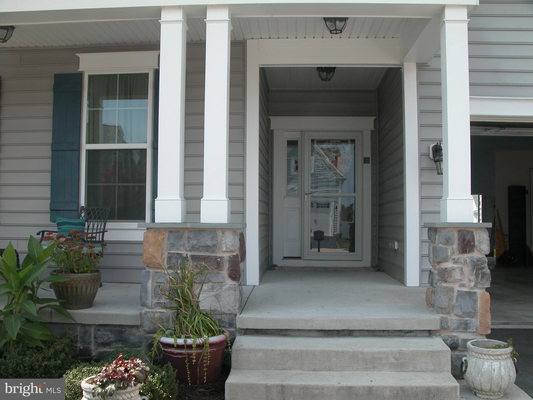 Lovely open floor plan with private back yard. Gorgeous entrance  with white tile that looks like marble , Vaulted ceiling in living room. Kitchen has large center island with granite counter tops.This home has 3 bedrooms with private bath in each. First floor master suite has soaking tub and separate shower, Granite counter tops,2 walk in closets. Den on the first floor can be a bedroom which would make this a 4 bedroom home it has french doors. Second floor has large bedroom with private bath and loft sitting area. Large walk in attic as well that could be finished off for more livable space  .Garage is 19.3x27 extra long and the crawl space is conditioned with dehumidifier and sump pump. Lovely front porch for sitting and people watching, Covered deck off the back of the home that looks out to the farm across the way and you can watch the deer and birds. Sun room off the kitchen leads to this space . Community has 2 pools one with a splash zone and a crab deck also kayaking in the pond. shuttle to the beach and many walking trails and a gym. Great community!!!!! Showings to start on September 15th