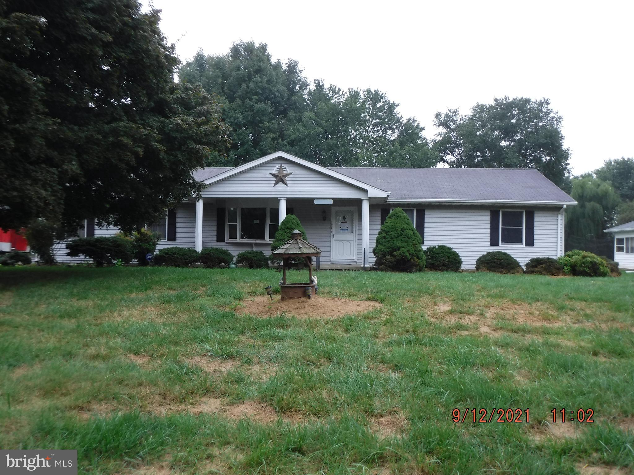 A roomy ranch on over an acre lot waiting for it's remodel. Conveniently located close to Route1 and 13. The long driveway provides plenty of extra parking when needed, in addition to, attached two car garage.  Easily revamp the extensive landscaping  with your gardening skills.  Property sold as is, no repairs will be made by seller.