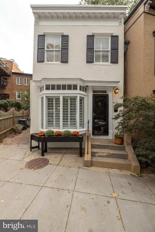 OPEN SUNDAY 2-4 pm. This is a really great and rare find:  A handsome, fully DETACHED  small city house in a prime Dupont location between Connecticut and Massachusetts Avenue with a 97 WALK SCORE!  5-min walk to DUPONT CIRCLE Red Line METRO and all Dupont Circle has to offer.  Light-filled with great room sizes,  remodeled kitchen and baths,  2nd Floor with 2 BRs and 2 BA's. Washer/Dryer on 2nd.  Nice fenced back area with  flagstone patio off kitchen plus another front exterior area with 2nd entrance directly into kitchen! Great space to garden and grill.   DON'T MISS THIS!!!