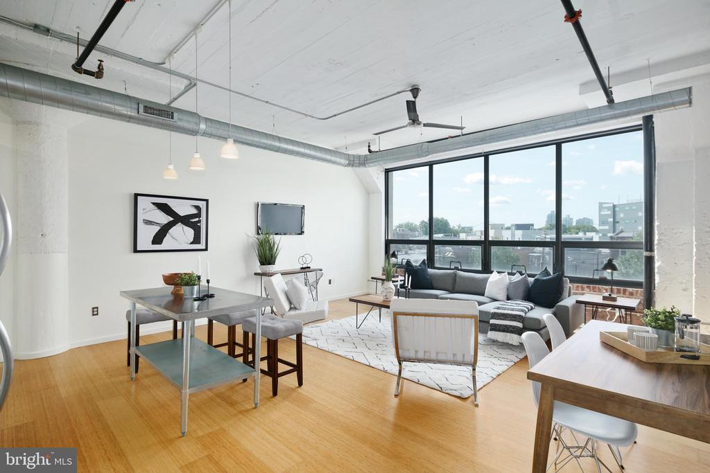This south-facing, 1072  Sq. Ft. condo is now available in the iconic Memphis Flats development, located in the heart of Fishtown. List price includes one parking space. This extra-wide condo unit features 11-foot concrete ceilings, a full exposed brick wall with original building door decor, concrete columns, bamboo floors, a full 18-foot wide south-facing wall window, higher-end modern design elements, stainless appliances, and an in-unit bosch washer and dryer. In addition to the parking space, this unit comes with a nicely sized climate-controlled storage unit. The building also features a newly remodeled fitness center and bicycle storage.