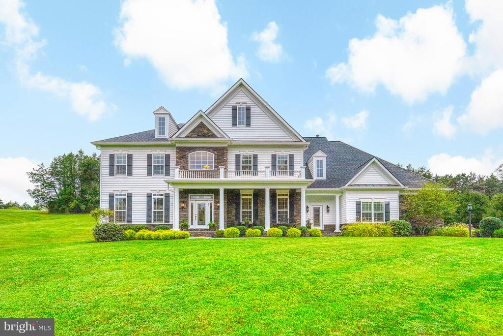 This Stunning Colonial in the Glens Neighborhood sits on 3 acres has beautiful landscaping, paved driveway with lighted columns,  Beautiful stone and shake siding with stone wrap around porch has Large Columns at front entry.  Features  5 beds,  5 1/2 baths, 4 beds has their own private baths.   Home shows pride of ownership through out.      Enter into a grand 2 story foyer with columns on both sides entering into Formal Dining Room and Living Room, beautiful hardwood floors throughout 1st floor except office has carpet.  Leads  to the Large Family Room with Stone Fireplace & box beam ceiling, around the left corner is the home office and right of the Family room is the Gourmet Chef's Kitchen includes, Level 5 Granite countertops and backsplash with 6 under cabinet lighting, Stainless Appliances, dishwasher, LG Clear view refrigerator, double wall oven, built in microwave, 5 burner gas cooktop, Large Island with Vegetable sink, 2 roll out trash cans, Breakfast room and a desk area.   The morning room has lots of light to enjoy a cup of coffee or enter out on the stone paver patio.   The large walk-in pantry leads to the mudroom you can enter through the double entry at front of the home that leads to the 3 car sideload garage with 2 automatic garage doors w/remotes.   The butler's pantry leads into the Formal Dining Room to enjoy those family gatherings, and has a powder room on the main floor.     As you make your way up the hardwood stairs with wood and iron railing either by the front stairs or the stairs off of the kitchen, hardwood runs through the hallway into the Large Owners Suite with tray ceilings and columns leading into the sitting area. The owners bath has large walk in shower with ceramic tile, dual   shower heads and handheld shower, Soaking tub, 2 separate vanities, dressing room  closet with built ins.  Upper-level laundry off of the Master Bedroom includes laundry sink and Washer/Dryer As-Is.  3 additional bedrooms carpeted with their own private 