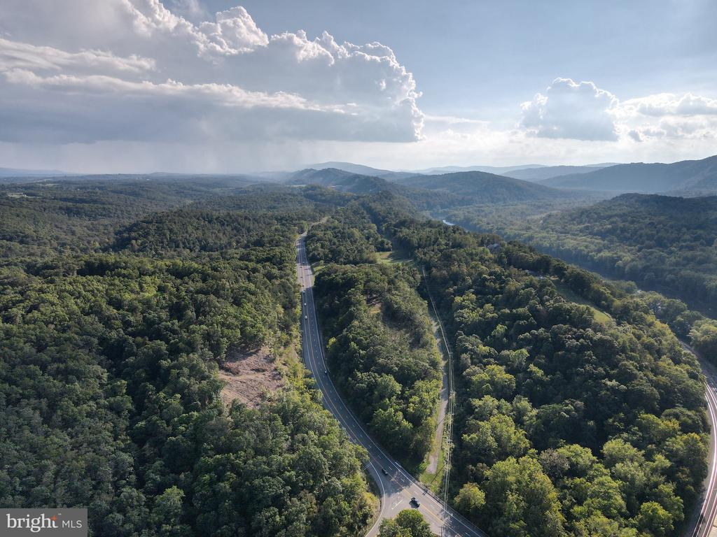 Much Sought After Land!   with a Gorgeous View!  20.46 acres that is just over the Maryland line in Berkeley Springs.  The entrance and road is already installed into the property.  This would make a great site for your private home.   Explore the possibilities of subdividing this land to have several building sites.   Berkeley Springs is nestled in the West Virginia mountains only 90 minutes from the Washington/Baltimore metro area. It boasts warm mineral springs, world class dining, blocks of distinctive shops, full-service spas and more.