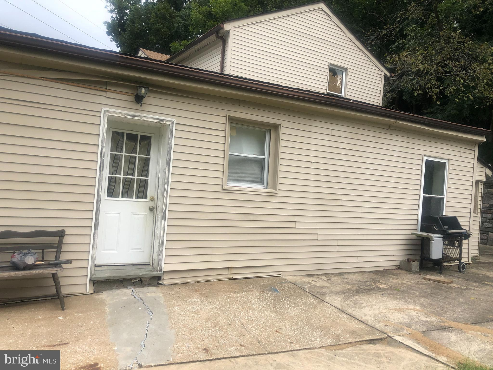 Bring your talents and creativity to this home . This could be a great value or even your own  home when all said and done . Take this ruff and make it a diamond . Home sits at the end of the street so it is private with lots of parking . Huge lot with trees blocking for privacy . Close to shopping and 76 .