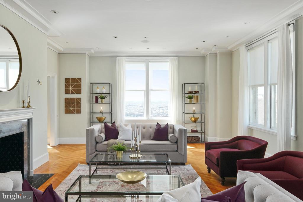 Located directly on Rittenhouse Square in The Barclay Condominium, this stunning residence blends modern updates with restored original architectural details.  Condominium 16B is a corner three bedroom plus den, three and a half bathroom with unobstructed Rittenhouse Square views to the west and sun-filled views of the city to the south. There is a grand gallery running the length of the home with 10' ceilings. A large living room, library/den with wet bar and bedroom suite all offer direct views onto Rittenhouse Square. On the other side of the living room is a sun-soaked formal dining room which leads into the chef's kitchen. The Bulthaup designed kitchen features custom cabinetry, granite countertops, a huge center island with breakfast bar, and high-end appliances including a Sub-Zero refrigerator/freezer, two Miele dishwashers, and Gaggenau wall ovens. The entire rear of the condominium is a lavish primary suite boasting his and hers bathrooms and an entire dressing room. Additional home highlights include an additional bedroom, powder room and laundry room.  No detail has been left undone in this one-of-a-kind residence--all moldings, millwork, flooring, lighting and built-ins are beautifully designed and customized for this home.  Residents of The Barclay enjoy a twenty-four hour doorman, fitness center, chauffeur driven Mercedes, on-site management, and individually controlled heating and air conditioning.  Stephen Starr's Barclay Prime steakhouse is located on the building's ground floor.