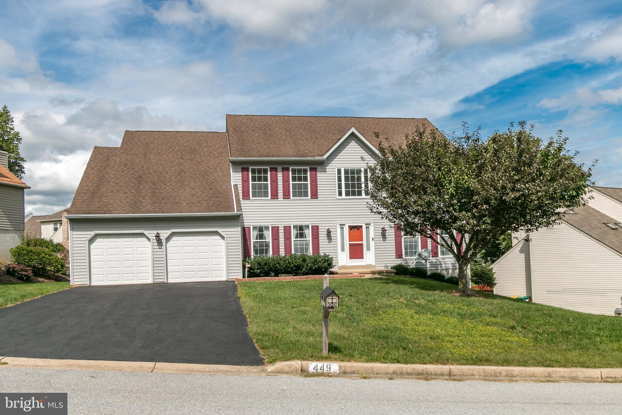Opportunity to become the proud new owner of a beautiful gem in the Red Clay School District!  Conveniently located only moments from parks, schools, restaurants, shopping, nature trails, gym facilities, major roadways and even PA, this home is brimming with so much to love.  Walk up the spacious driveway and into the front door flanked by bright sidelights and immediately notice the two-story entryway that features a grand and welcoming entrance.  Located on either side of the foyer are the living room and dining rooms.  Here you will find recently installed neutral carpet, wood flooring, attractive crown molding and chair rail and tall windows that fill the rooms with lovely sunlight.  Continue into the impressive and expansive eat-in kitchen with beautiful cabinetry, upgraded counter tops, tile back splash, center island with built-in storage and electric, gas cooking, built-in microwave, a very large pantry closet and a double sink with a bright garden window.  This room is ideally open to the inviting family room with tall ceilings, wood flooring and a cozy gas fireplace.  There is so much space here for you to arrange your furnishings just as you choose. You and your guests will love the open design to  the kitchen and eating area.  More features to love on this main living level include the private powder room, tucked away laundry room with a useful utility sink, coat closet and best of all...a first floor bonus room that can be used a home office, den, playroom, bedroom or however you wish!  There are so many options for utilizing this space.  Access the well crafted screened-in porch from the kitchen and delight in this outdoor/indoor space that you can enjoy throughout most of the year.  It accesses the maintenance-free deck with vinyl rail that is perfect space for enjoying the outdoors.  You are sure to appreciate all of these options for an outdoor use of space.  Continue upstairs to find even more impressive features that include four generously sized 