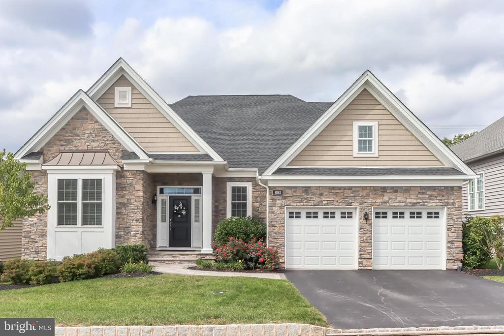 This impressive 4 bed 3 bath colonial home within the sought-after Regency at Kimberton Glen is ready for you to move into! This is a 55+ community that provides fantastic benefits including yard maintenance, driveway maintenance, and snow removal while also providing access to amenities including a community pool, community building, workout facilities, tennis/pickleball courts, and much more! As soon as you enter an elegant foyer welcomes you with a striking staircase, double-height ceiling, and neutral walls just waiting for your personal touches! Elegant features fill the home including Ethan Allen and Ballard Designs light fixtures, custom blinds and shutters, shadow box molding, chair railings, crown molding, recessed lighting, and gleaming hardwood flooring in the main living spaces. One of the highlights of the main level is the dazzling kitchen that is a chef's dream with a built-in fridge and wine fridge, a large center island with seating for 4-5, stainless steel appliances, stunning light fixtures, a breakfast nook, and a charming subway tile backsplash. The dining room with tray ceilings and gorgeous light fixtures has enough room for a full-size dining table. It flows seamlessly into the spacious living room with a cozy gas fireplace for cold winter nights! Opposite the dining room is a private office with built-in shelves excellent for a work-at-home setup. Off the living room is the owner's suite featuring tray ceilings, a gorgeous chandelier, a dedicated bath with a glass door shower, two huge separate vanities, and a walk-in closet with custom-built shelves. A second bedroom on the main floor is perfect for a sitting or sewing room. Finishing the main level is the laundry room and second full bathroom. Upstairs, the second level features the remaining two lovely bedrooms that share a Jack and Jill full bathroom. The unfinished walk-out basement offers great potential for additional living space or for storage. Outside this wonderful home is a rear 