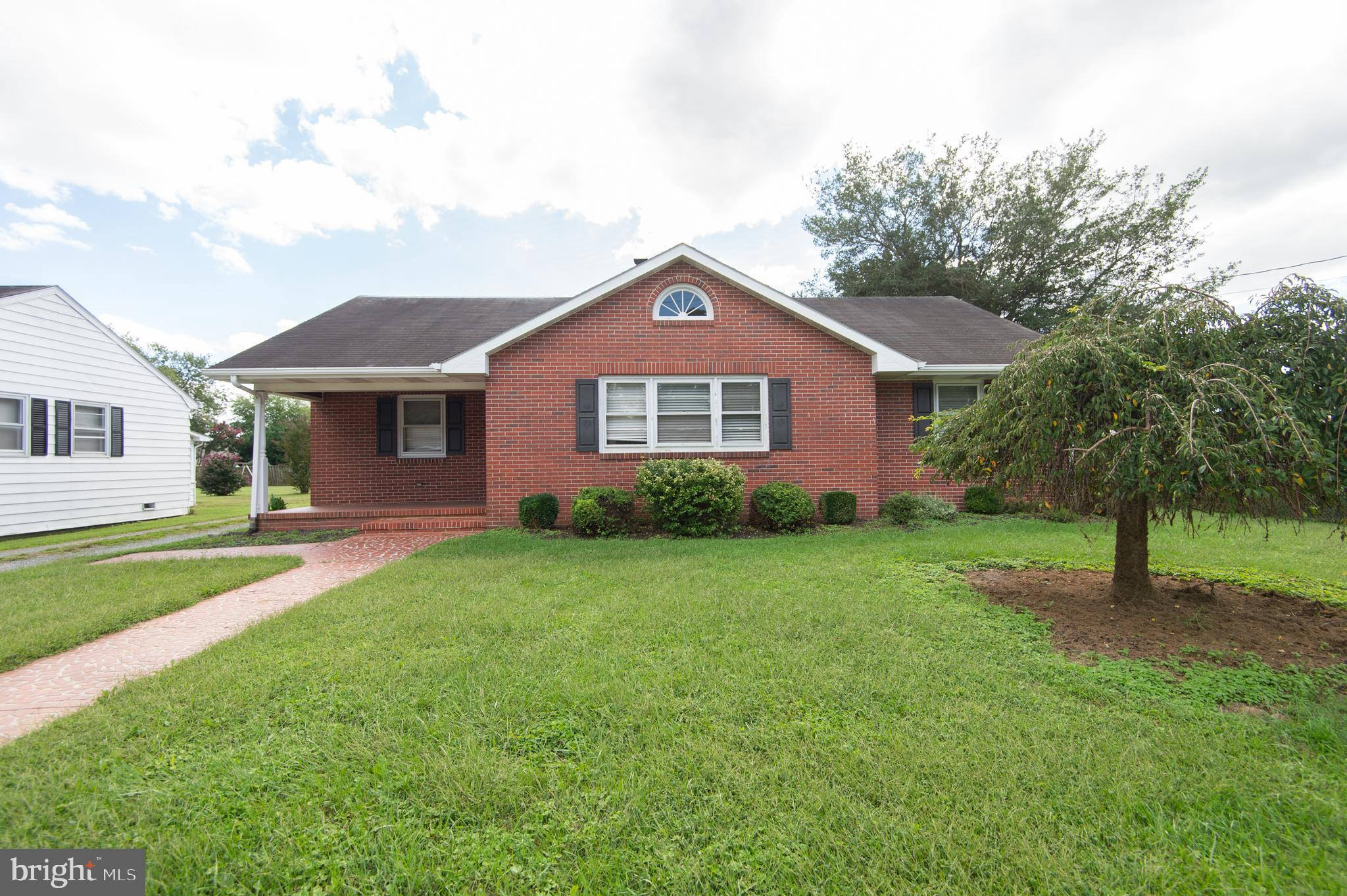 Looking for mid century modern- this is it!  Brick rancher with gleaming hardwood floors.  Large living room with fireplace and cool built-ins.  Great  opportunity to put your spin on this one! Large block outbuilding with two bays and second floor storage.  Imagine the possibilities!