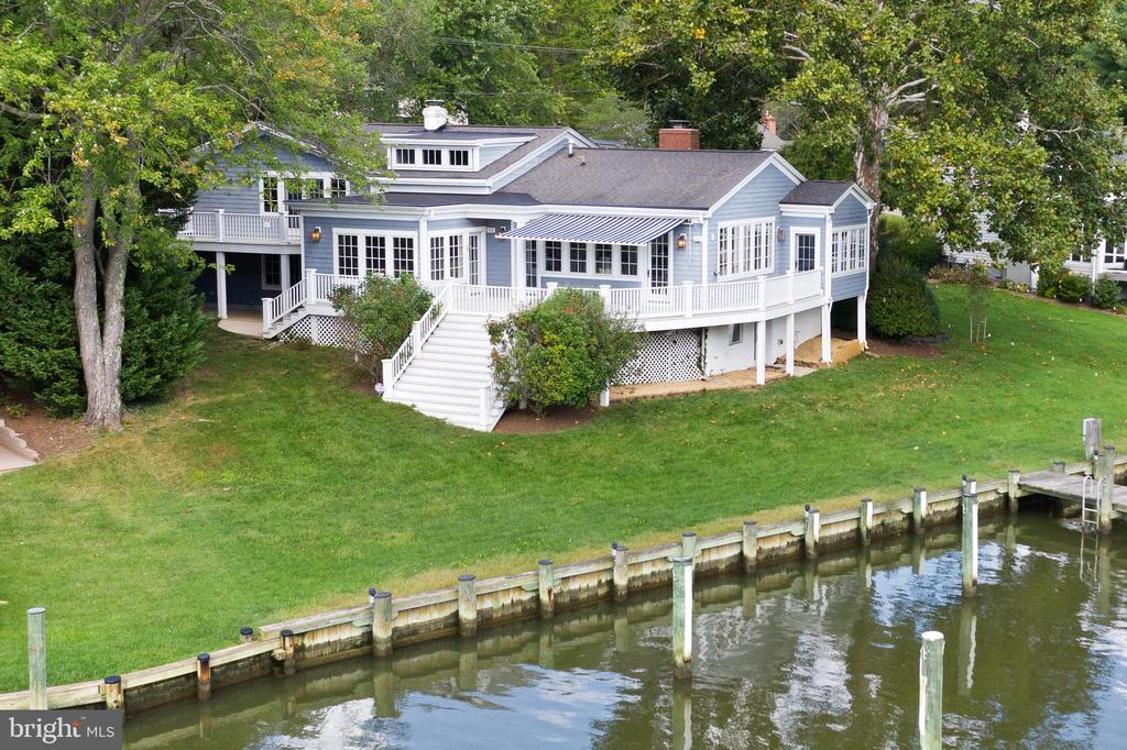 Let's talk water! Amazing waterfront on Little Aberdeen Creek*   7+ ft Protected  MLW with  gorgeous straight down the creek  views to the South River* Slips that  accommodate a large motor or sail boat with additional room at the pier to configure additional slips or boat lift.   This Coastal style home with it's welcoming front porch has Lovely curb appeal but does not prepare you for what you see when you walk in.    The views take your breath away.  There is a  gorgeous vaulted and  light filled  great room which offers floor to ceiling windows and doors that focus  on and amplify  the sweeping views down the creek.  Beautiful light cherry built in cabinetry is carried throughout the  great room and warms the gourmet kitchen and breakfast nook. These rooms all access  a large  deck for entertaining  on the water.  Tucked off the rear corner of the house is  a pretty sunroom with french doors that  look out to the pier and  makes  a great office, reading or music room.  A few steps down from the kitchen is a walk-out  lower level  with a  cozy den,  2nd wood burning fireplace, adjoining guest bedroom, bath and laundry.  One additional  level down is the recently renovated recreation room with plenty of room for kids  to play  as well as a  new  steam shower bath that is is a great addition when returning  from a day on the water. This level has walk-out access to the newer pier.  The upper level offers a master bedroom  suite opening to a private  morning deck, two other large bedrooms and a full bath.   The community of Wild Rose Shores  is only minutes to Historic Annapolis, and the Eastport Maritime District.  It is an easy commute to both  DC and Baltimore.  Your family and friends will love to visit!