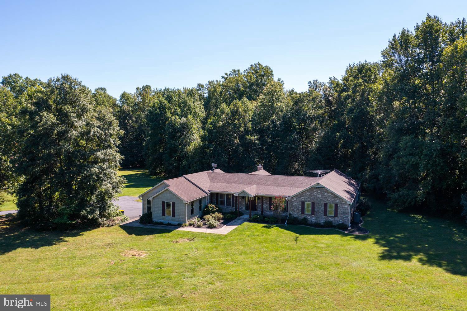 This is a rare find in Smyrna. 10+ acres. This home has so much to offer. If you're looking for that one floor living with some unique character this is it. Hardwood floors offered in the living and dining area, and ceramic HEATED  flooring offered in the kitchen and Master suite. Beautiful gas fireplace with a stone facing that gives you that country living look. 14 X 12 master bath with a ceramic walk-in shower.  A 46x20 garage, 20 x 18 deck, and a huge pole barn out back with concrete flooring and electric.  You need to see this to appreciate. Make your appointment today. Seller offering $10,000 towards closing cost.