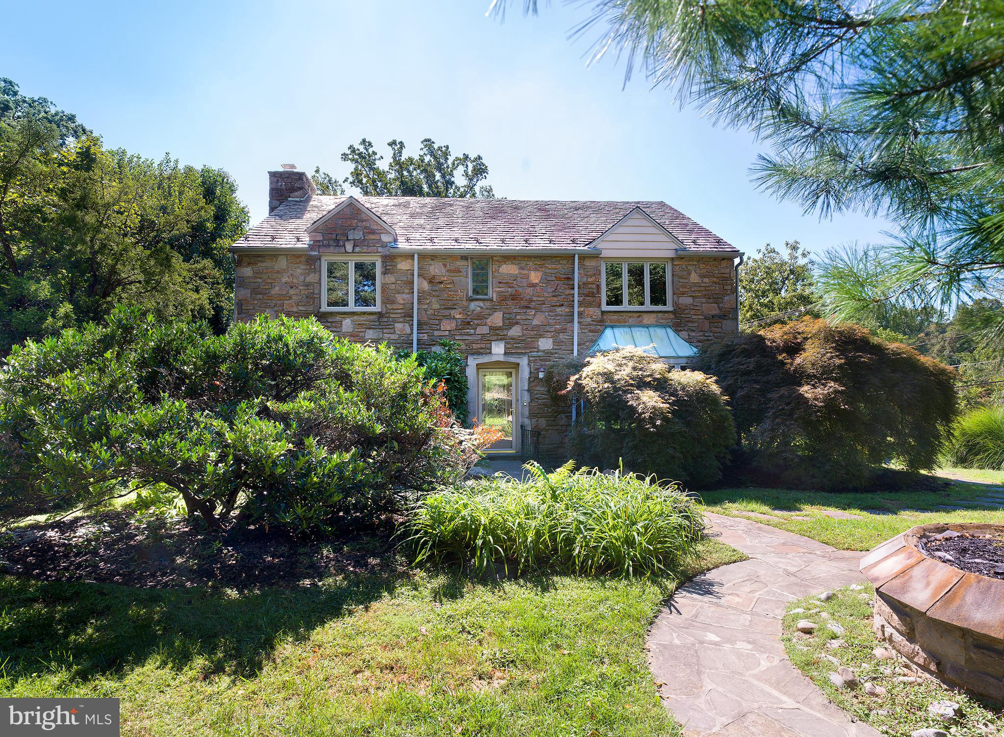 This charming, updated, center-hall stone colonial is situated on a secluded premier corner lot, in a quiet neighborhood filled with nature, yet so close to all major shops; Wynnewood Town Shopping Center, Whole Foods, Suburban Square, and Narberth, and with easy access Center City.    With a spacious living room with cozy fireplace to the left of the entrance, and a formal dining room to the right, 478 Ballytore Road is perfect for entertaining. The recently expanded, gourmet kitchen boasts timeless features, like wooden cabinetry, granite countertops and a large center island. Its modern amenities like stainless appliances, Viking cooktop, Electrolux refrigerator & freezer, and separate wine cooler/dry bar area, make this kitchen ideal for preparing and enjoying meals with family and friends. From the kitchen there is access to a welcoming family room, with custom built-ins, which opens to the sunroom with stone floors. The sunroom leads you to the private rear yard, with a large inground, heated saltwater pool and classic stone patio to enjoy all summer long.  On the second floor you will find the en-suite primary bedroom with a full wall of fitted closets. Plus there is more than enough room for family & guests across the three additional bedrooms and hall bathroom. The finished lower level is equipped with a laundry room, powder room, dry bar with cup dishwasher,bonus room, and access to the attached, four-car garage.  All of this with many recent renovations, including a newly installed 5-ton cooling system, tankless water heating system, pool with recent conversion to salt water and new pump, a remodeled sunroom, a newly installed reverse osmosis drinking water system, and new flooring throughout the second floor.  This home has it all, including ample storage and located within the Lower Merion School District.