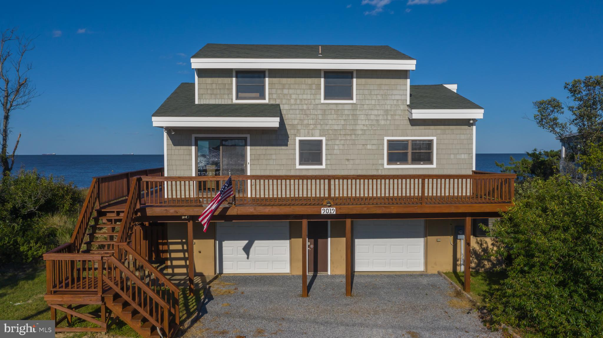 Breathtaking views coupled with comfortable elegance! This waterfront retreat offers thoughtful design to ensure the best panoramic views of Delaware Bay. As soon as you enter the main level, the Delaware Bay and Prime Hook Wildlife Refuge views are front and center!  Outdoor living space is a must when living directly on the water and this home has so much to offer. The main level features a screened-in porch, an open deck with 180-degree views of the Delaware Bay, while the front side of the home features and an expansive open deck with sweeping views of the Prime Hook Wildlife Refuge.   The main level features the great room, dining room, kitchen, owner's suite, and laundry/guest bedroom.  The upper level features two additional guest bedrooms with views of the Prime Hook Wildlife Refuge as well as a guest bathroom.  Prime Hook beach is very unique due to the fact that the beach is exclusively private.  Literally, you walk down your private boardwalk, cross over the dune and your personal heaven is right there. After a long day on the beach, you'll enjoy rinsing off in the outdoor shower.  As an added bonus, the home features an enclosed two-car garage, making storage a none issue.  The septic system has been certified and all repairs will be completed prior to closing.  The septic system is permitted for a 2 bedroom home even though there are additional bedrooms that can be utilized. All that is missing from this home is you. Come take a tour of this once-in-a-lifetime property!  This is your chance to own bayfront property at the Delaware Beaches!