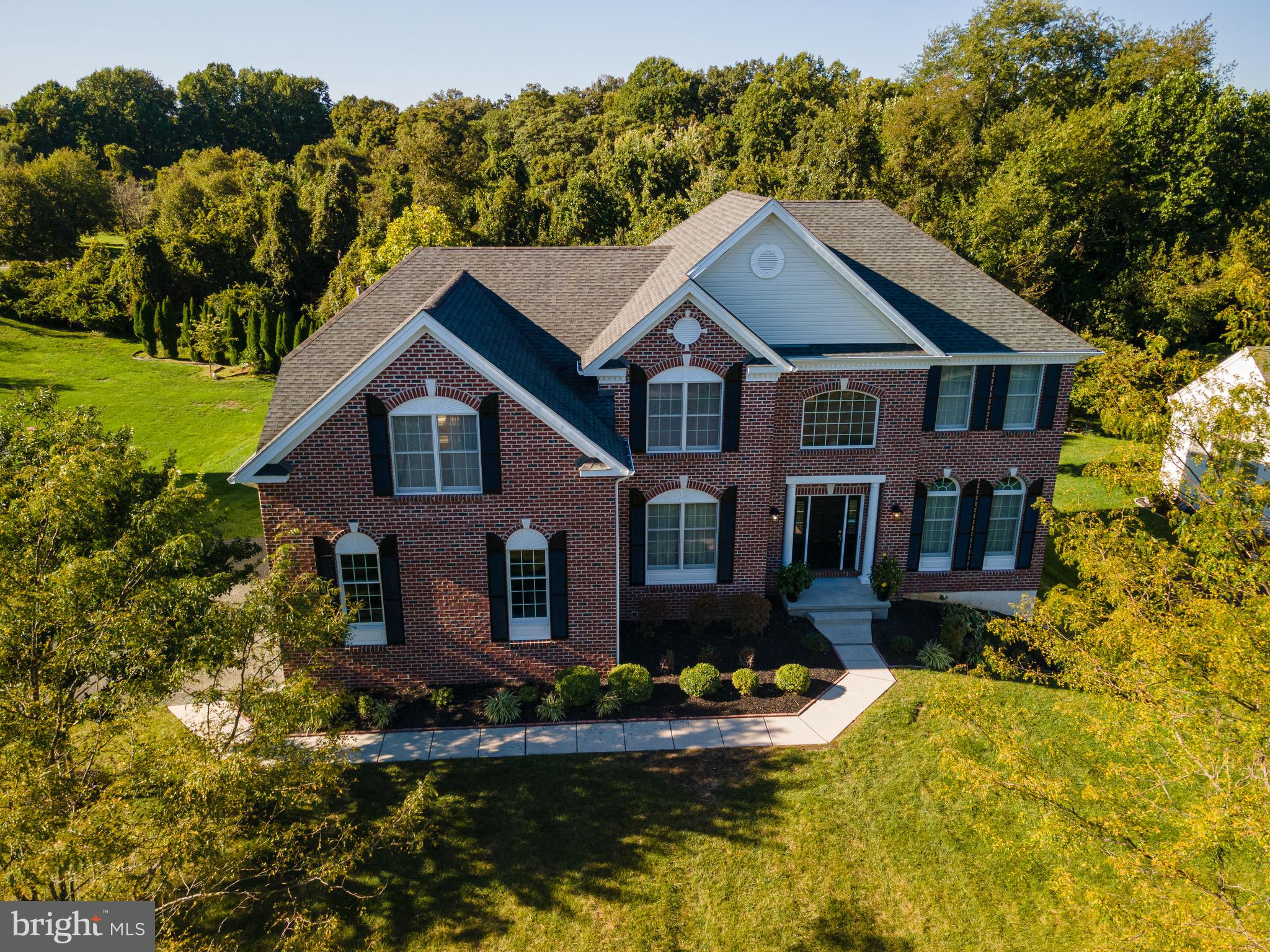 This is a rare opportunity to own a luxurious dream home located in the prestigious Woodlands at St. Georges in Red Lion Chase by Toll Brothers.   This massive estate is 4,475 sq ft located near the end of the cul-de-sac which backs to amazing woodland views.  Entering the foyer you notice the hardwood flooring along with  the breath taking staircase that wraps around the entire home.  Step into the gourmet kitchen that includes all stainless steel appliances, granite countertops, and upgraded cognac cabinets.  Enjoy your meals outdoors on hot summer nights with an oversized deck right off the rear kitchen!  The family rooms is absolutely stunning offering amazing natural light, gas  fireplace, and views of the luxurious staircase.  The master bedroom suite offers an additional seating area, luxurious jacuzzi tub in the master bath, and  his and her closets.  The lower level offers a finished basement that includes an additional bonus room/office, workshop, and private outdoor patio.  As an owner in this highly desired community you have access to community pool, work out center, and a private playground.  This home gives the buyers peace of mind as it includes a 1 year 2-10 Home Warranty.  Schedule your private tour today and be prepared to be blown away!