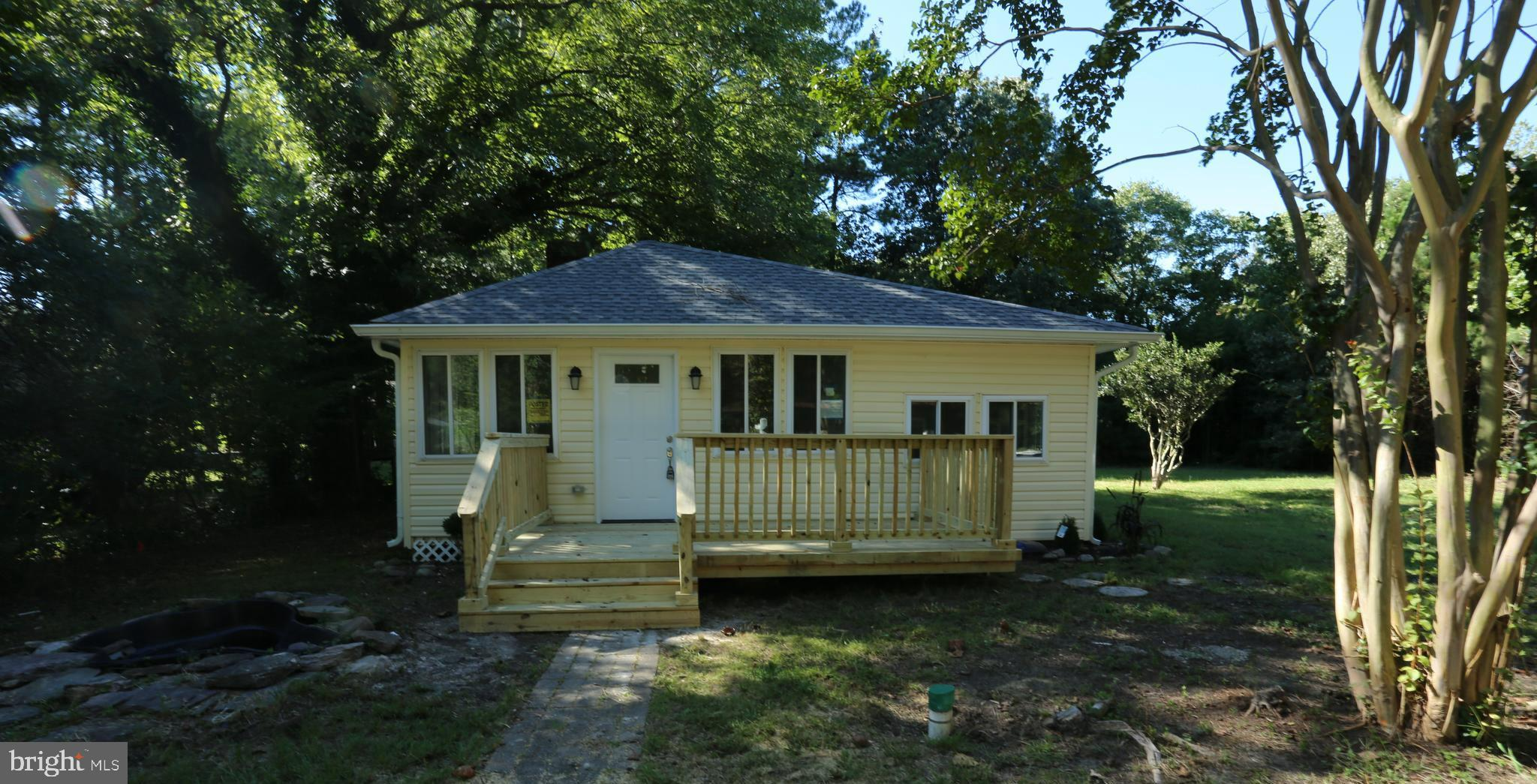 Completely  remodeled bungalow/cottage with all new central a/c, new roof, siding, windows, gutters, appliances, flooring, bathrooms, kitchen, wiring, plumbing.  Home is on holding tank. 3 Bedroom, 1 bath cottage with water views.  open floor plan; New deck ; Detached Garage on over 1/2 acre (.57). Verify flood insurance. Seller financing will be considered with acceptable down payment.