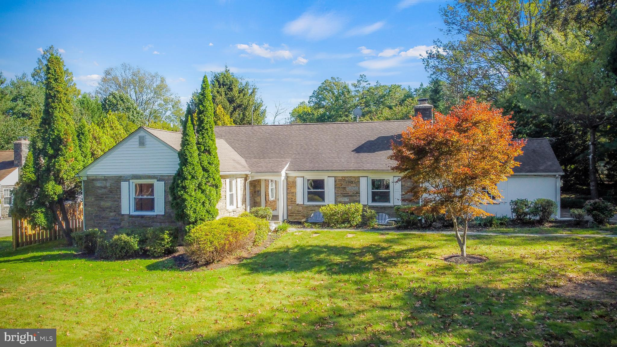 """Welcome home! Great opportunity to live in Gladwyne. Nice location and within walking distance to Gladwyne Village and. easy access to Center City. This classic Cape Cod style is situated on approximately .50 acres of beautiful trees and foliage. The convenient """"L"""" shaped driveway gives you convenience and easy access to Conshohocken State Road. Enter the foyer into a welcoming 2 story floor with gleaming hardwood floors throughout the entire home. The open floor plan leads you to the formal living room with plenty of windows, allowing a great amount of sunlight to drench the living room—a good-sized dining room with an open concept that will lead to the kitchen. The kitchen has plenty of wooden cabinets, beautiful new 2021 granite countertops, a gas stove as well as stainless-steel appliances. From the kitchen walk into a Cozy oversize sunroom with a great view to the rear fenced and private back yard. This room gives you extra space for indoor entertainment or quiet relaxation. Also, the main floor offers the convenience of three generous bedrooms two of which had their carpet replaced with new hardwood floors back in 2014. The new remodeled 2018 two bathrooms and the laundry room are completing the first floor. On the second floor, there are two other large size bedrooms that are ideal for kids or guests with a shared bathroom in the hall. Also in the hallway, is a large walk-in closet which provides tons of storage. The lower level is an unfinished basement that can be used for extra storage. There is also an attached two-car garage that can be used for parking or as convenient added storage. As for additional parking, there is plenty of space on the driveway. All this in award-winning Lower Merion schools. Come and see this beautiful home before it sells. Book your appointment today!"""