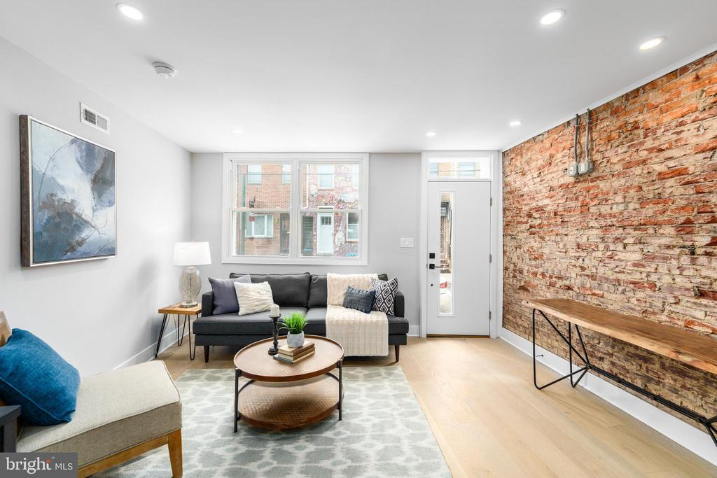 This beautifully reimagined custom renovation project features two (2) bedrooms and three (3) full bathrooms. Outfitted with modern finishes, creative layouts, and sleek design, this Passyunk Square home is a wonderful addition to the neighborhood.  Enter into the bright living room, complete with brand new hardwood floors and ample natural light from expansive front windows. The kitchen offers an open concept with  brand-new countertops,  abundant cabinet space,  and stainless appliance which flow into a spacious dining and entertainment area.  A window overlooks a sunny back patio, perfect for a quiet afternoon lounge or dinner outside.  The primary bedroom offers plentiful space and a his and hers closet as well as an on-suite bathroom. The secondary bedroom offers similar organized storage, and bright eastern light.    This delightful block is steps from the Passyunk Avenue corridor, offering local favorites and a vibrant neighborhood atmosphere!