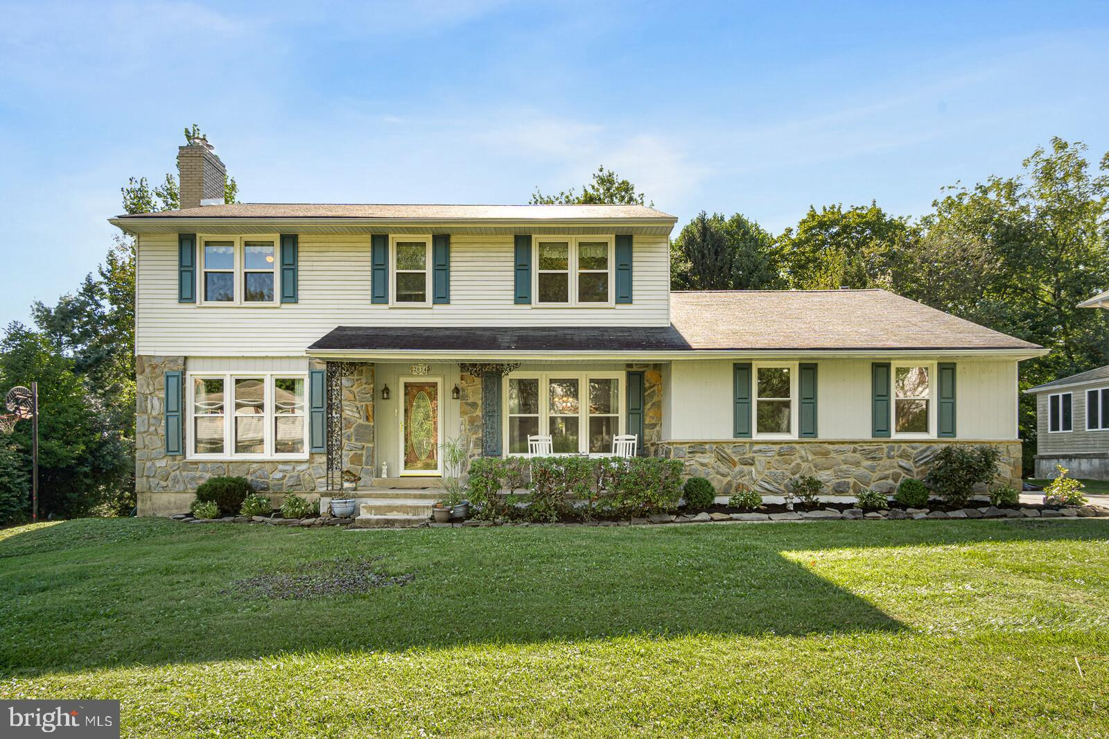 """Come see this backyard oasis with a stunning in-ground pool! Classic stone and siding 4BR, 2.5 BA Regent model colonial located in a prime North Wilmington location! Beautiful refinished hardwood floors (2019) throughout, generous room sizes, and upgrades galore check all of the boxes! The backyard is a perfect blend of ample yard space, a large patio area, and the inground pool with new pump (2021), updated liner with insulation (2015). The front walkway and charming front porch lead you to the spacious center hall foyer. The welcoming living room has crown molding and a newly rebuilt wood-burning fireplace. The formal dining room features chair rail and crown molding and opens to the completely renovated kitchen! The gorgeous eat-in kitchen features 42"""" wood cabinetry, beautiful granite counters, luxury vinyl tile flooring, custom tile backsplash, recessed lighting, and updated appliances. The family room is spacious and inviting with hardwoods and stone fireplace. The main floor office, charming and renovated powder room with shiplap walls, and convenient level laundry room round out the main level. The beautiful wood staircase guides you to the second floor with a large hallway and a bedroom located in each corner of the home. The spacious primary suite has a walk-in customized California closet plus a luxurious spa-like bath (2018) with a tiled floor and shower with frameless glass door, gorgeous vanity, fixtures, and lights. Three additional bedrooms and a bonus upstairs room share the beautifully updated tiled hall bath with wood vanity and heated whirlpool tub. The basement is spacious and offers multiple uses and ample storage and was recently updated with new carpeting. Additional features include replacement windows; new central air (2019), hybrid heat-pump (2014) with oil backup. Don't miss this lovely home!"""