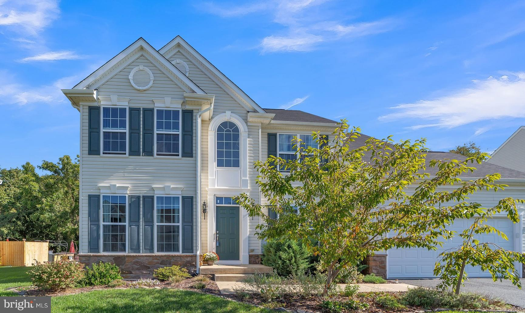 """A """"Commuter's Delight"""" at less than 3-miles from Rt 13 and only 7-miles to the Rt 1 & Rt 299 interchange!  Upon arrival at this 5-year-young Handler-built, two-story colonial, notice the two-car garage and mature landscape.  Inside, the gleaming hardwoods in the Foyer make a great first impression.  The living room features custom paint, large windows and crown moulding.  Directly across the Foyer is the Dining Room where the custom paint, crown moulding and large windows continue.  Returning to the foyer we enter the open-concept Great Room across the entire rear of the home.  Notice the gas fireplace and many large windows (plus a sliding door) flooding this space with light.  In the eat-in Kitchen, stainless appliances, espresso cabinets and tasteful granite counters will satisfy any chef!  A sunroom-style bump-out provides a large area for casual dining.  Beside the kitchen, find the main-level powder room and laundry room along with access to the garage. Return to the front hall and make your way up to the Bedroom level.   Once upstairs, find the Owner's Suite.  Here you will be pleasantly surprised by dual walk-in closets and a luxurious full bath ...  with double-sinks, tile flooring, a soaking tub and a beautiful tile shower.  Three more bedrooms and a hall bath wrap-up our tour of the second floor.  Take the stairs down to the full, unfinished basement with rough-in plumbing for a full bath.  Use your imagination to customize this level to the entertainment / hobby / work-from-home space of your dreams.  Return to the Great Room and step onto the enormous rear deck (approximately 18' x 16') with 6-person Caldera Hot Tub.  An unexpected amount of space for outdoor entertaining and summer barbecues awaits you here.  Take a moment to take-in the tranquil views of the tree-lined open-space behind ... perfect for nature lovers.  Welcome Home!"""