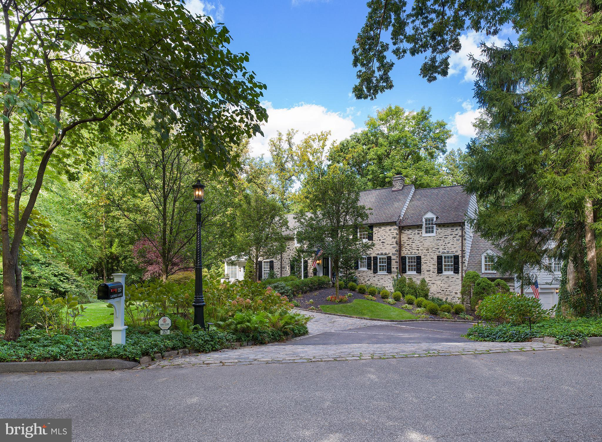 Welcome to this quintessential Main line home in one of the most sought-after neighborhoods in the Philadelphia suburbs. This Walter Durham center hall colonial with upgraded over-pointing mortar work, mature and lush landscaping, and touches of cobblestone and slate welcomes you with open arms.  Upon entering, take in the sheer elegance with its luxurious millwork, large rambling rooms with deep windowsills, 4 fireplaces, built-ins and restored original random width pegged floors. Although traditional, the newly renovated kitchen with open concept family room speaks to the carefully crafted Fred Bissinger addition adding modern conveniences for a truly updated experience. A brand-new laundry room, as well as a first-floor study is among this home's other attributes. The light filled second floor is open and oversized feeling elegant and extravagant. The main bedroom suite with fireplace and large walk-in closet is a private oasis, and the two large jack and jill bedrooms with adjoining bathroom is accommodating and private. A bonus room on the first floor with full bathroom and large closet is a perfect fourth bedroom or guest suite if more space is needed. The finished lower level is truly a thing of beauty. The once summer kitchen is now a large open space with a walk-in fireplace, a bank of large windows overlooking the yard and Italian porcelain floors, perfect for those looking to entertain, or even create a multi-use space for everyday fun. Enjoy the newly renovated full bathroom on this floor and with TWO garages, both equipped with heating.  Walk-to location for restaurants, shopping, and the train, with easy access to center city, King of Prussia, and Conshohocken. Nothing has been spared for this well-appointed home. Home will be available for private showings starting 10/2/2021.