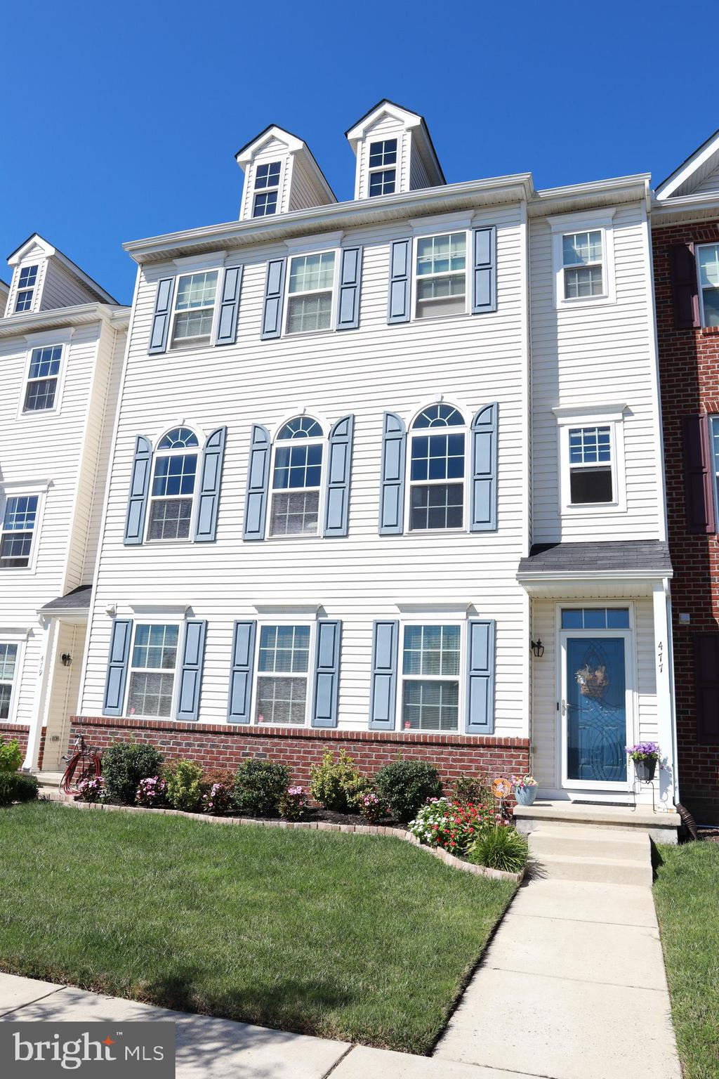 """You want Middletown, you got it!  Check out this amazing townhome which is within walking distance of all the action! You will be wowed from the front door!  On the first level you'll find an oversized (rear parking) garage with plenty of space for two large vehicles and extra room for storage.  There is also a room which could be used for entertainment or an office with an adjoining bathroom.  Follow the hardwood steps to the 2nd level where you will enjoy hardwood everywhere you look.  There is a gourmet kitchen with granite countertops, 42"""" cabinets and stainless appliances.  Take a step outside from the  sliders onto the private balcony which is  just perfect to enjoy on these cool autumn days.  There is also a spacious dining and living room space  and powder room. On the 3rd level the owner's suite offers lots of space with a large closet and en-suite 3 piece bath.   The soaking tub is the highlight of this beautiful space.   Just down the hall you will find a laundry area, 2 other large bedrooms and a full hall bath.  Come see all the reasons why you will want to call this house your new home!"""