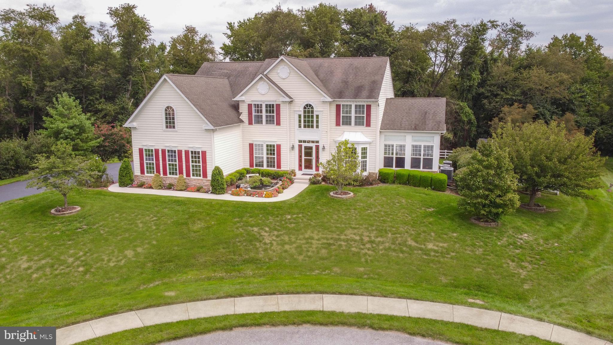 This gorgeous Estate Home is located at the end of a private cul-de-sac with a large .81 acre fenced lot that backs to woods for privacy.  Upon entry, you will be greeted with gleaming hardwood floors that extend through much of the main level, the butterfly staircase, and the 2nd-floor hallway.  The dramatic 2-story foyer is naturally luminous with a large transom window and an exquisite chandelier. The main floor also includes a formal Dining & Living Room that enters the sunshine-filled Solarium that is loaded with windows, a trey ceiling, and even includes its own HVAC zone. The Kitchen is a cook's paradise with a large island and ample counter space with a walk-in pantry, double wall oven, downdraft cooktop, above counter microwave (new 2021), cherry cabinets, and a great breakfast bar that opens to the Morning Room w/vaulted ceilings and many more windows. There is a large laundry/mudroom with a laundry tub and storage. The Kitchen also opens to the spacious Family Room, loaded with windows, and a gas fireplace that flows to the Sunroom. There is also a Study/5th Bedroom and full bathroom. The 2nd floor includes 2 large bedrooms adjoined by a Jack & Jill bathroom, an additional bedroom with a private full bathroom, and a large Owners Suite with a sitting room, walk-in closet, vaulted ceiling, and a recently updated bathroom with a soaking tub and a separate shower with glass doors. Don't miss the massive 47' x 20' Trex deck that includes a huge ramp on one end and steps on the other side that go down to the private rear yard and French Doors to the unfinished basement.  The basement could easily be finished to enjoy the additional 2,400 sqft. The seller has already spent the money on the 4-piece plumbing for a future full bathroom.