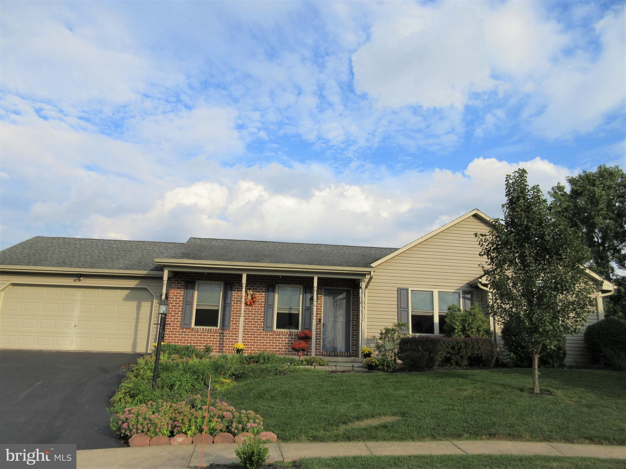 Don't miss this well maintained one story with 3 bedrooms, 2 full baths, 2 car garage and basement. Come and visit the beautiful kitchen that features granite countertops, tile backsplash, island, extra cabinets, gas stove, built in microwave and a Pella door with built in blinds. Relax on the spacious deck or covered front porch and enjoy the many flowers. The master suite was recently remodeled and features a master bath with tile floors, a roomy shower with glass doors, huge walk in closet and a convenient laundry area. Washer and dryer are included. There's a cathedral ceiling in bedroom 2. Enjoy the central vacuum with 5 hookups, economical gas heat and cool central air. There is a shed and basement for storage, and the second washer and dryer set is included. Located on a quiet cul de sac just a short walk to the middle school and high school.Showings begin October 5. All offers are due by October 10 and will be presented on October 11