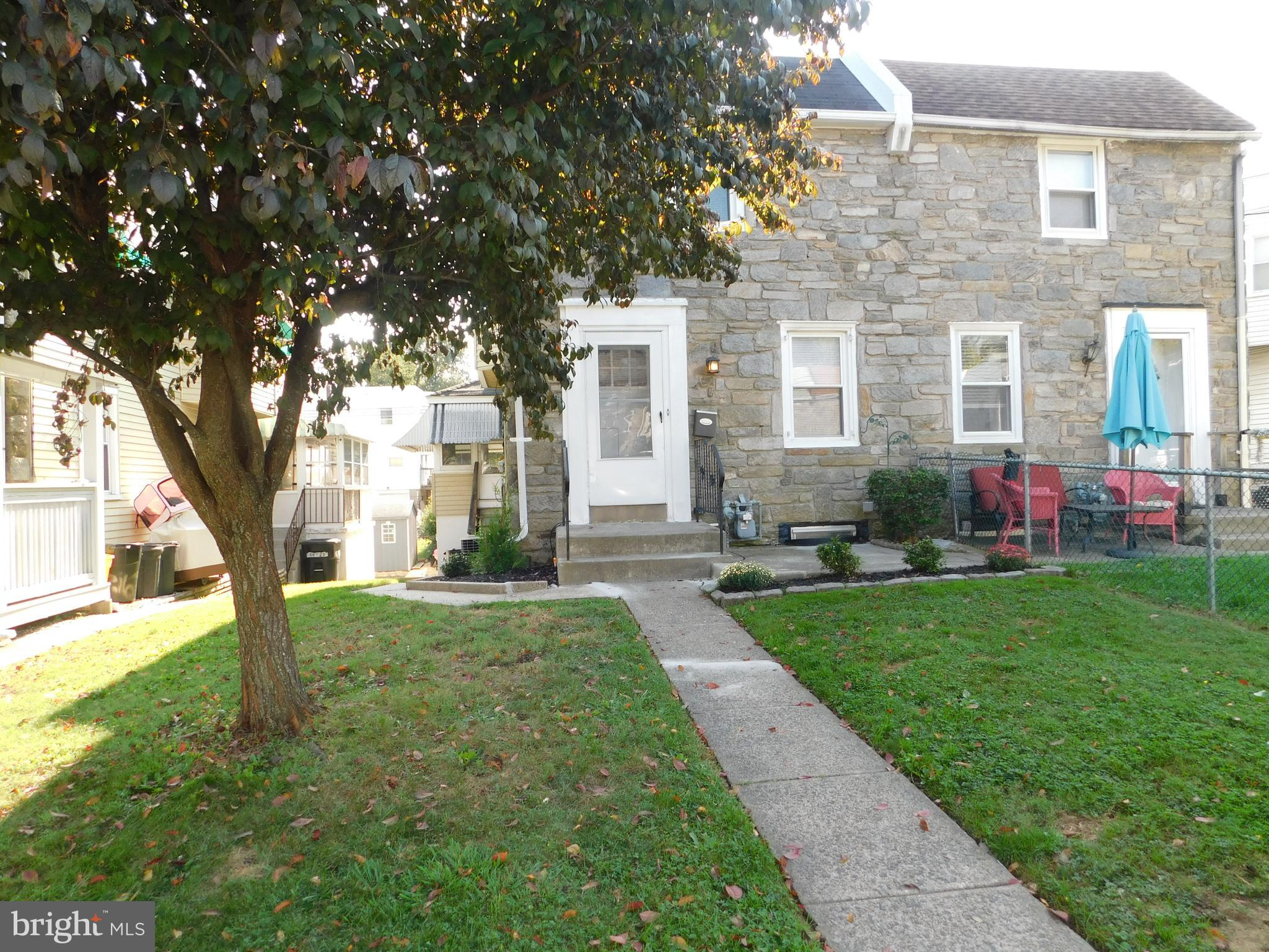 Well maintained stone twin home featuring  large living room, formal dining room, new modern eatin kitchen w/dishwasher, enclosed side  porch w/exit to side yard.  2nd floor has three nice sized bedrooms and a hall bath, Basement is finished w/separate laundry area and an outside exit to attached garage.  This lovely home also has a  front patio and a built in storage area under the side porch.  Convenient to shopping and public transportation
